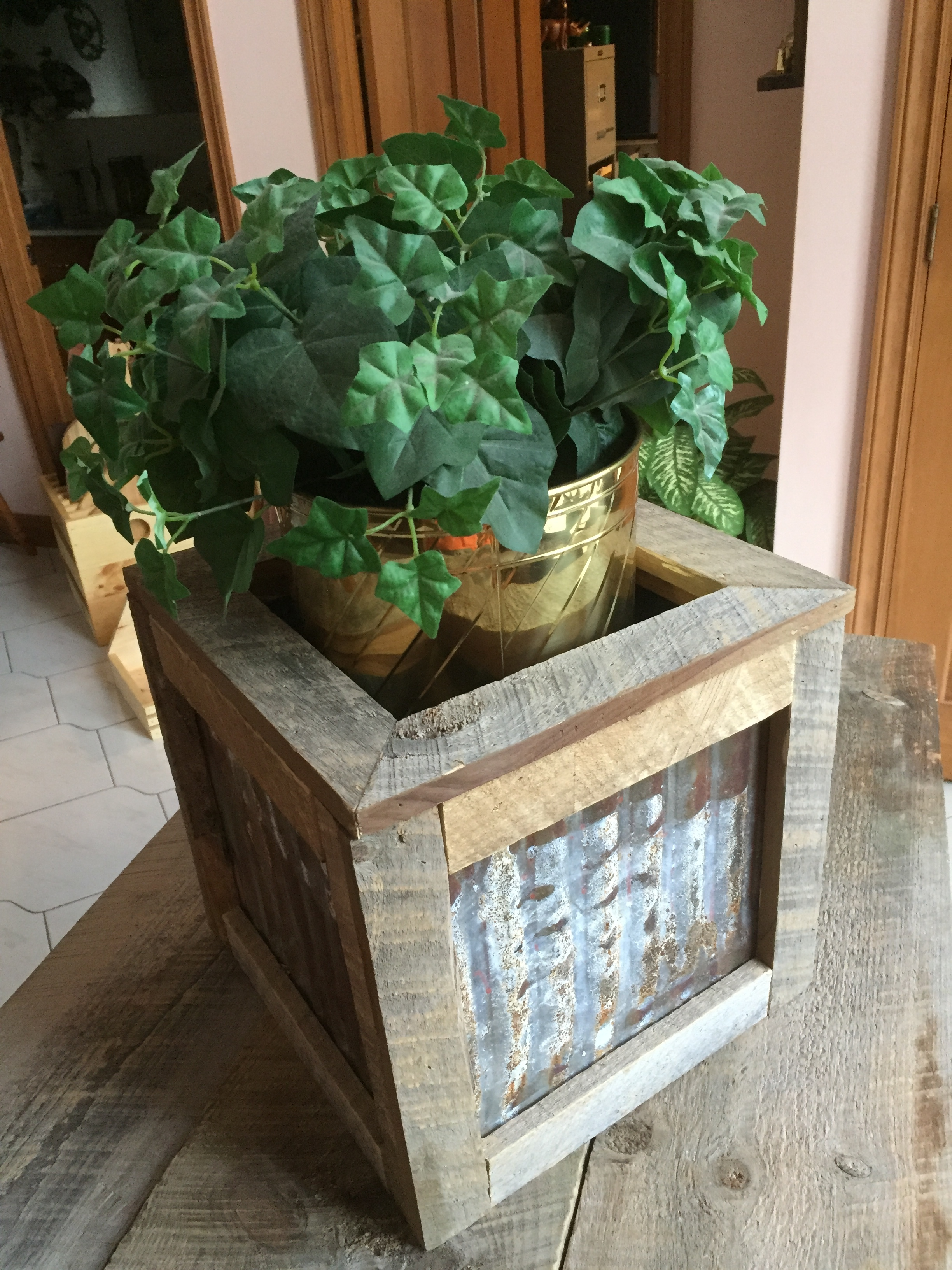 - Planter made from Barn boards and metal roof