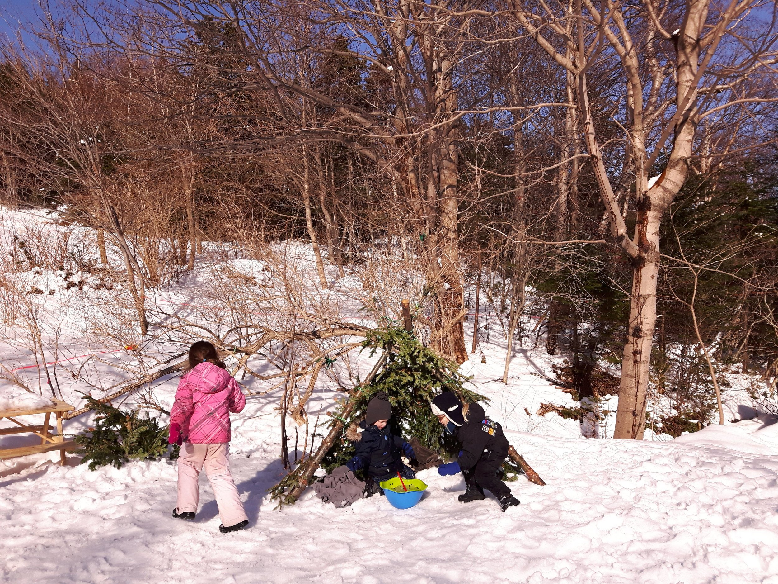 Yes, we can forest school in the winter too! - Children are adaptable and resilient - we need to remember this. Our northern climate does pose a challenge to the safety of children being outside for extended periods of time during extreme cold snaps, but that is why we have a neighbourhood indoor space to warm up, have snacks / naps, regroup, and continue our learning from our outside time!