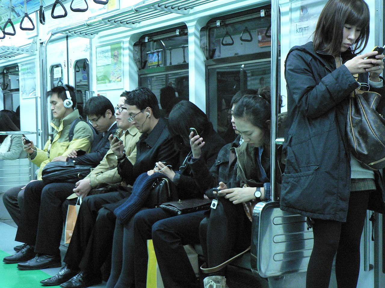 People engaging with their phones on the Seoul Metro. Image credit:  Marc Smith  [ CC BY 2.0 ]