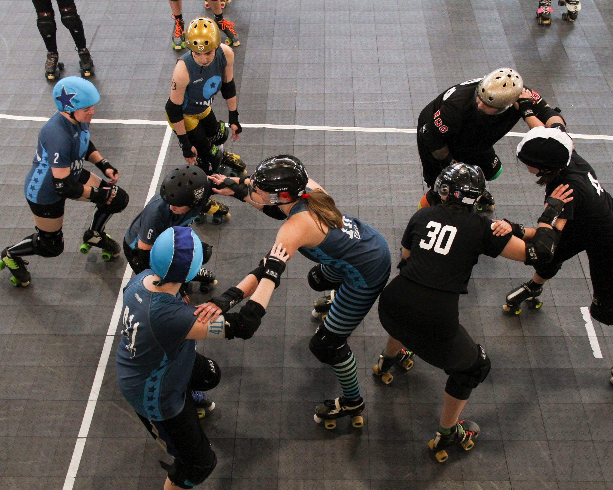 Here, Baby and Rad make a tripod with Cryptic Kablam from Green Mountain Roller Derby at PVRD.