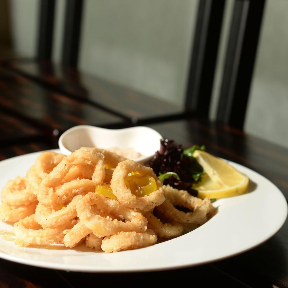 Thai Spiced Calamari - kale salad and peanut soy dipping sauce