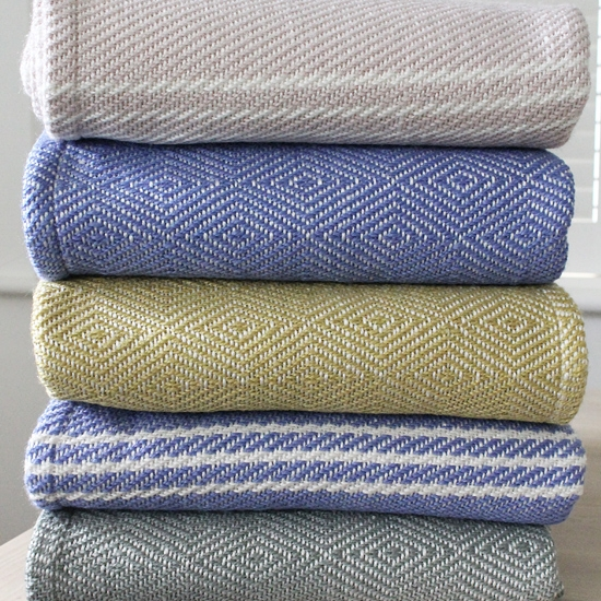 2. Textures - Cuddle up under one of our Scandinavian style blankets. These soft and cosy blankets make great sofa throws and blankets for the bedroom. They are all handwoven from approximately 50 recycled plastic bottles! Why not try mixing different styles together for an ever cosier result? The blankets also sit perfectly with our cushions.