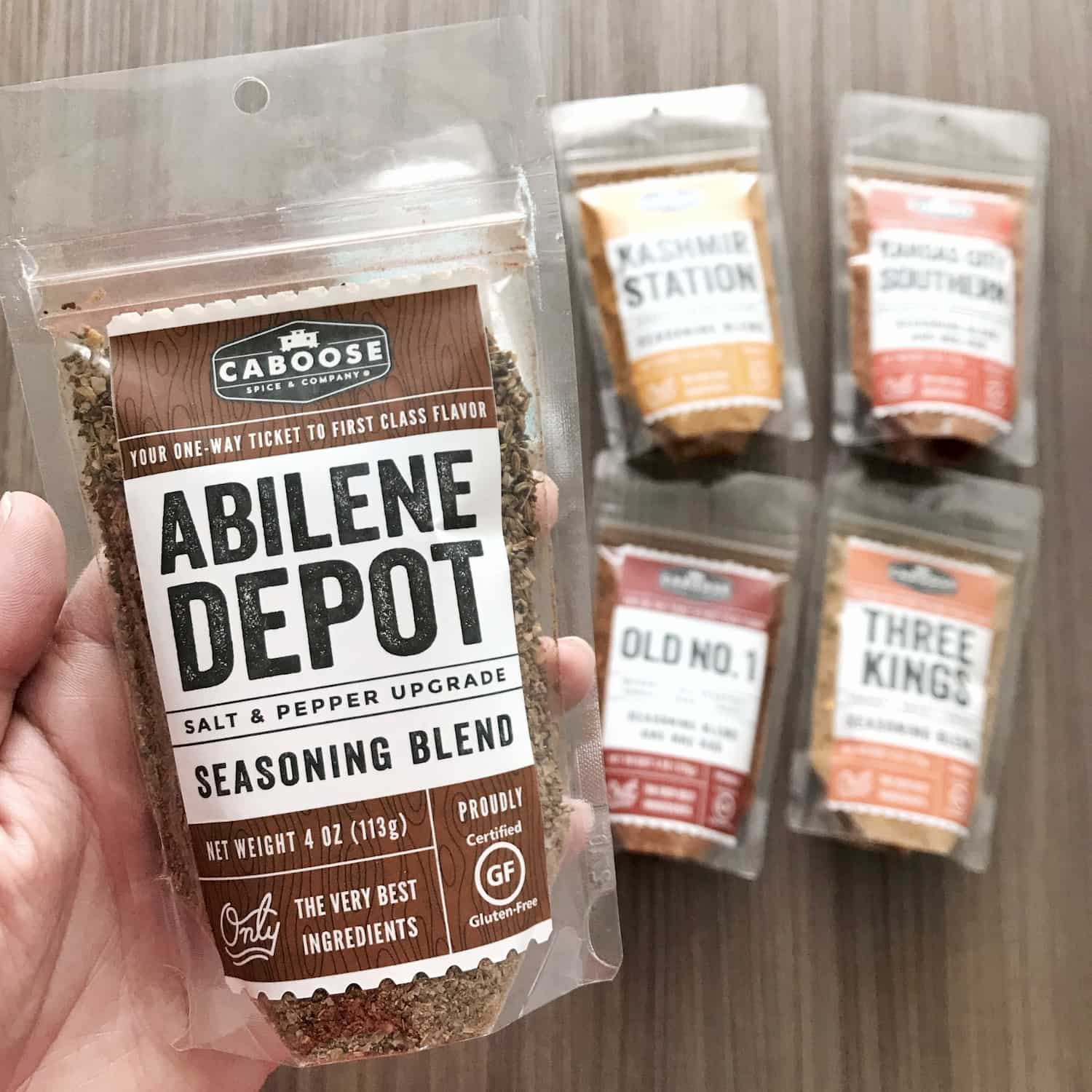 Abilene Depot 4 oz pouch in hand size reference.jpg