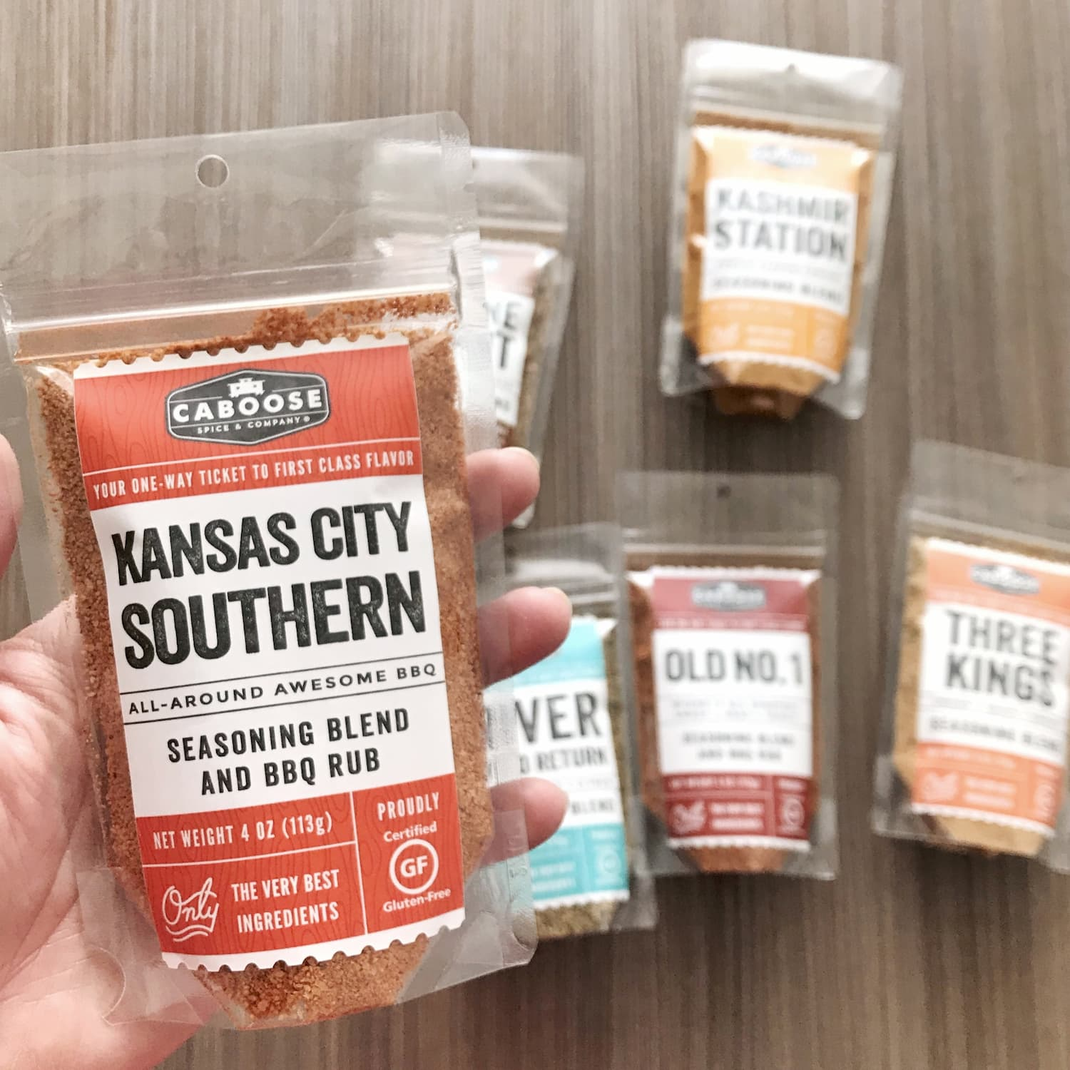 Kansas City Southern Rub 4 oz pouch in hand size reference.jpg