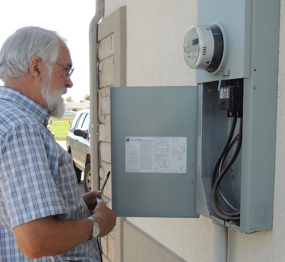 Inspecting main electrical panel.jpg