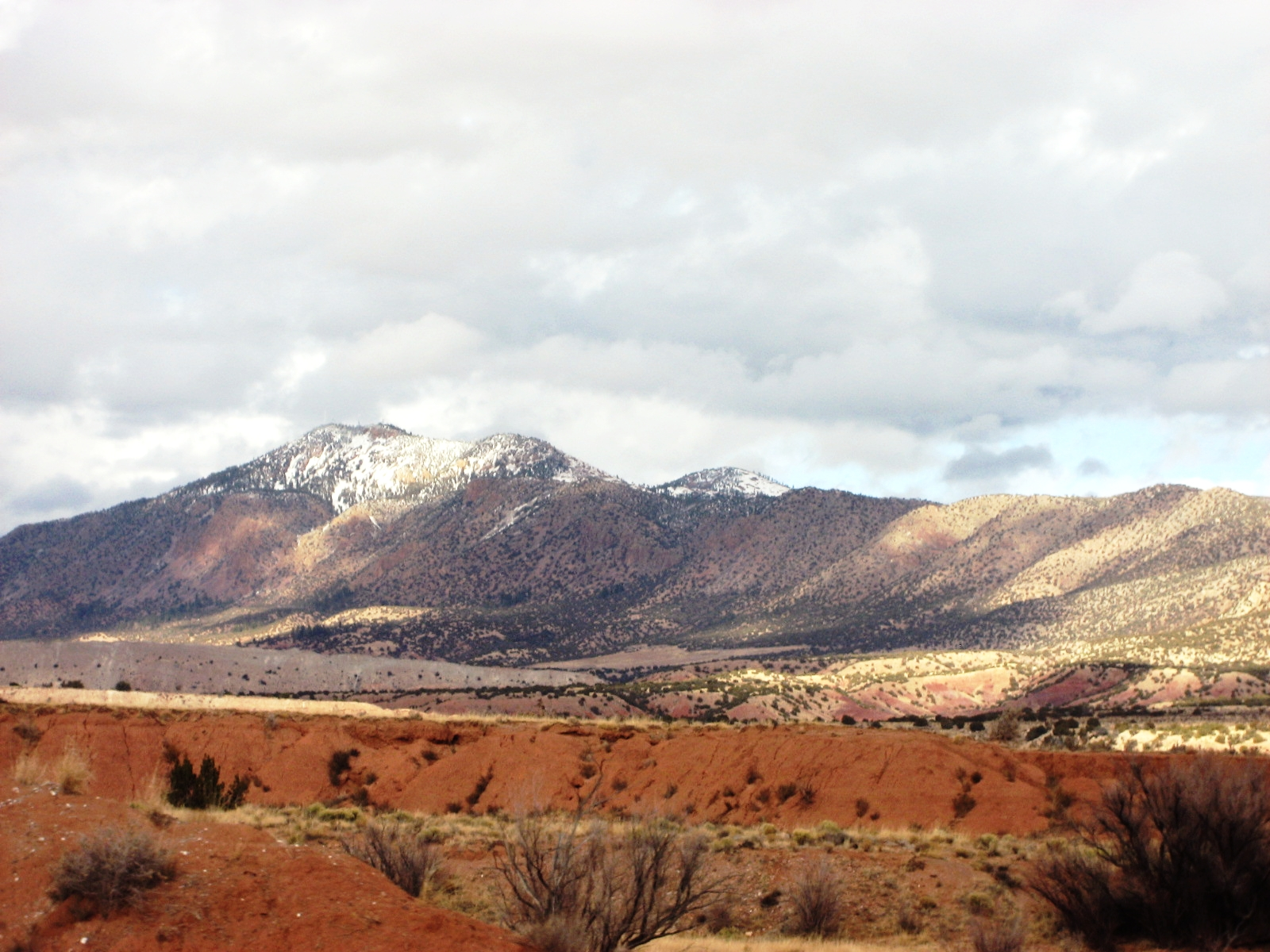 The land of enchantment. Photo taken out the car window while traveling between Santa Fe and Albuquerque, New Mexico. Years ago my parents moved here. They had enough of the winters in the Midwest, I get it.