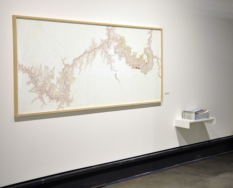 """Grand Canyon Suicide Map , digital inket print, map pins, 39″h x 86″w, 2011, and  Grand Canyon Suicide Map/Metta Meditation, Grand Canyon National Park , four-color offset print, illustrated folded sheet map, 2012, exhibited in """"Shadows, Traces, Undercurrents,"""" Katherine E. Nash Gallery, UMN, Minneapolis, October 16 to November 17, 2012"""