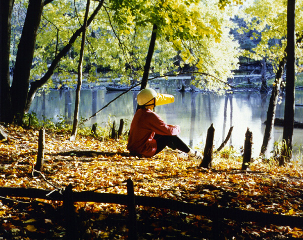 "Jan Estep,  Focus Bonnet, Fall Photograph , 1996, color photograph, size variable, from ""Survival Wear""."