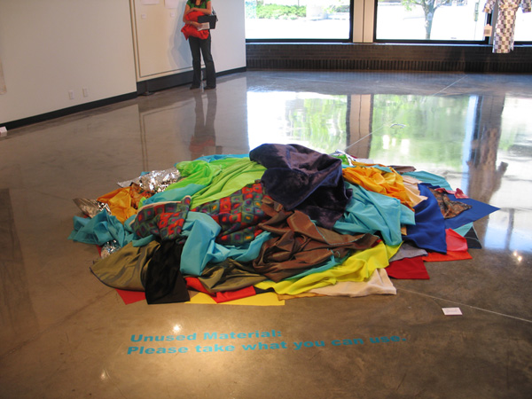 Jan Estep,  Unused Material: Please Take What You Can Use , 2007, fabrics to be recycled back into use.