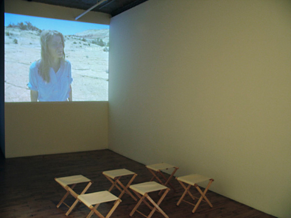 Exhibition view, Jan Estep,  Ad Infinitum , video projection, camp stools, Art in General, New York, 2005.