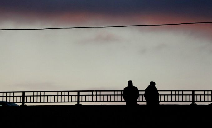 Two people watch the train roll in from the Harmonee Avenue Bridge, All Image Credit to Journal Sentinel