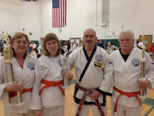 Our first competition as orange belts in Tang Soo Do--with Master Causerano (2013). Left to right: Cynthia, Lydia, Master Mark, Aleck.