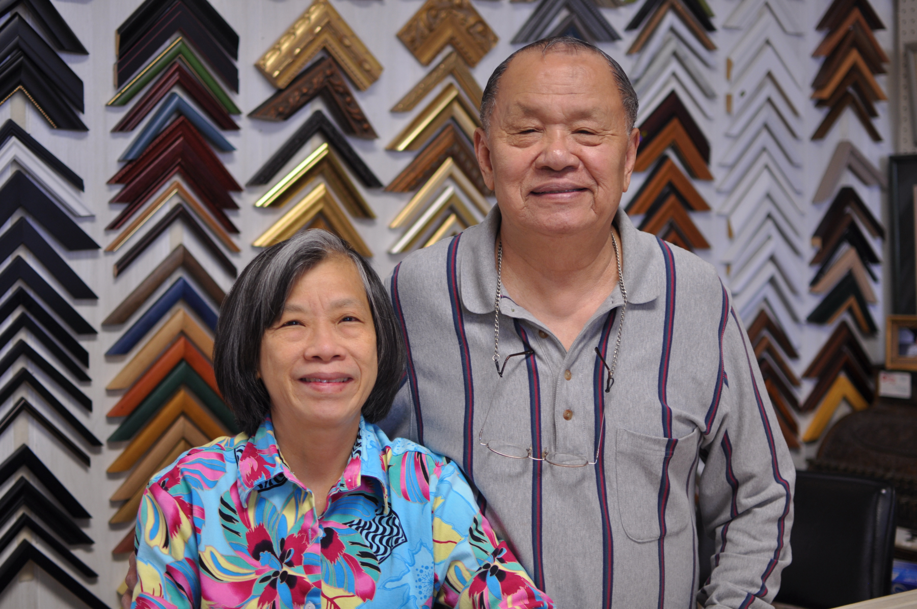Our story - Jack and Kitty have a collective 45 years of experience crafting beautiful custom frames.Jack is a watercolor artist and cook, specializing in traditional Chinese cuisine. Kitty is a dedicated gardener who enjoys growing vegetables from her native Thailand. They are proud parents to Joy, a freshman at Northwestern.
