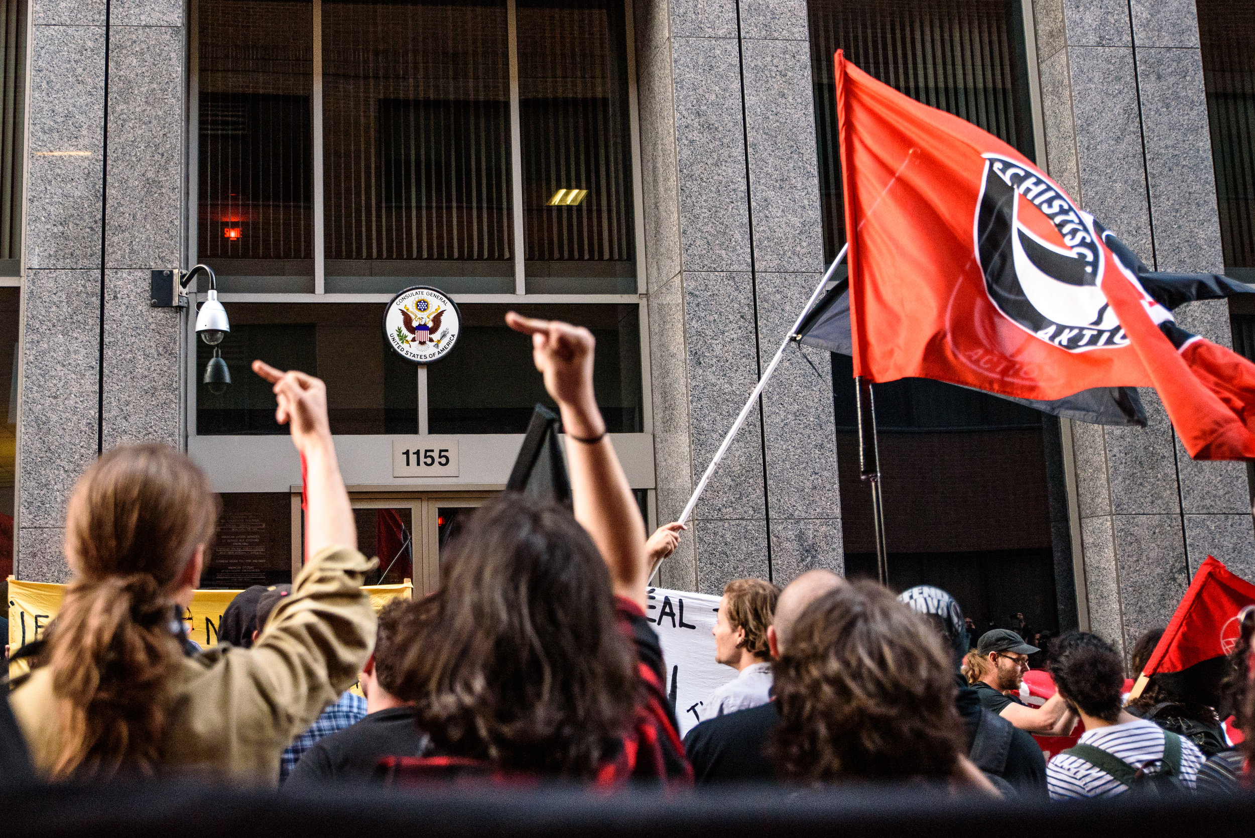 Antifascists protesters gather in front of the US consulate in downtown Montreal.