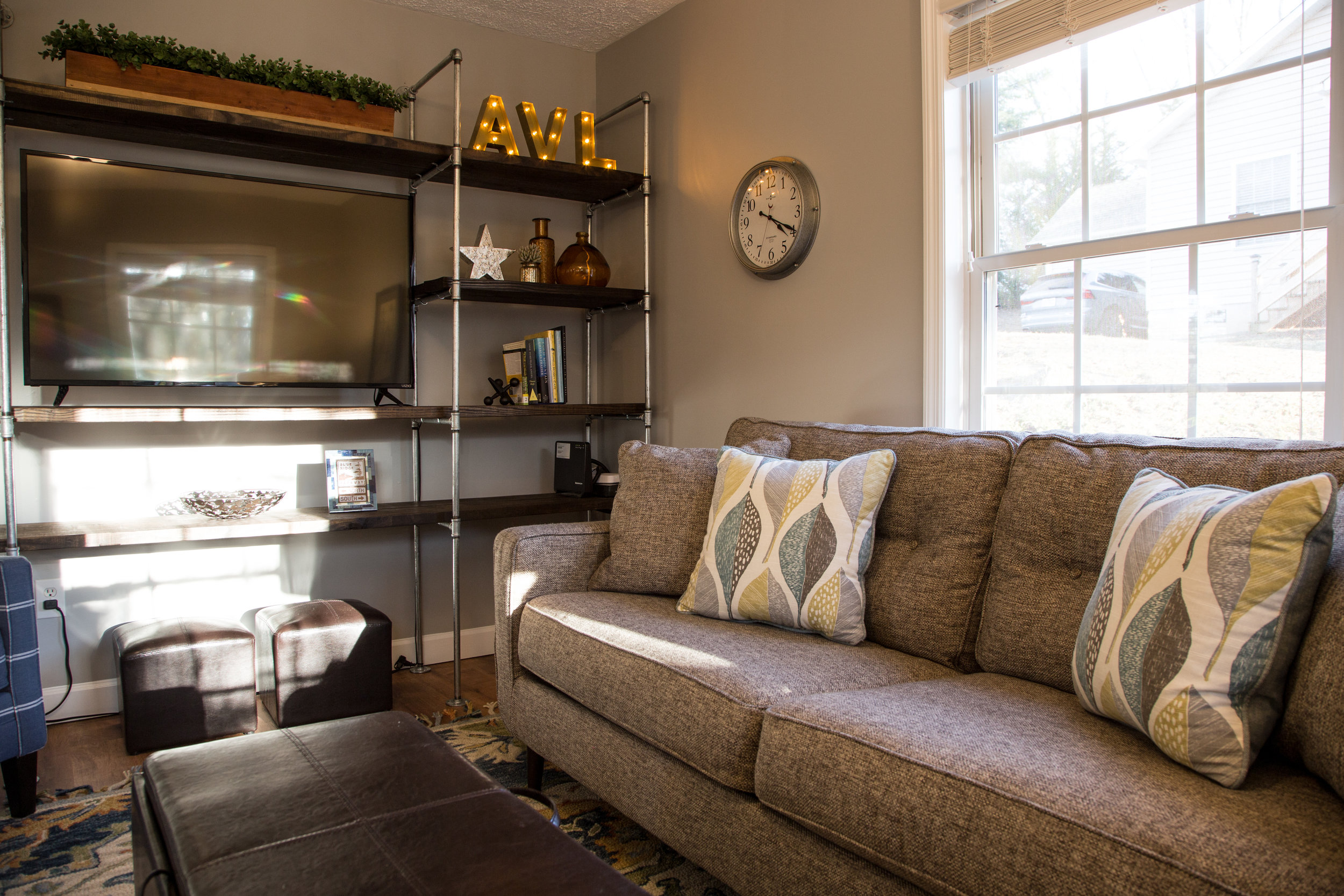 Local art, regional literature, and a flat screen TV with streaming services to create a place that feels like home.