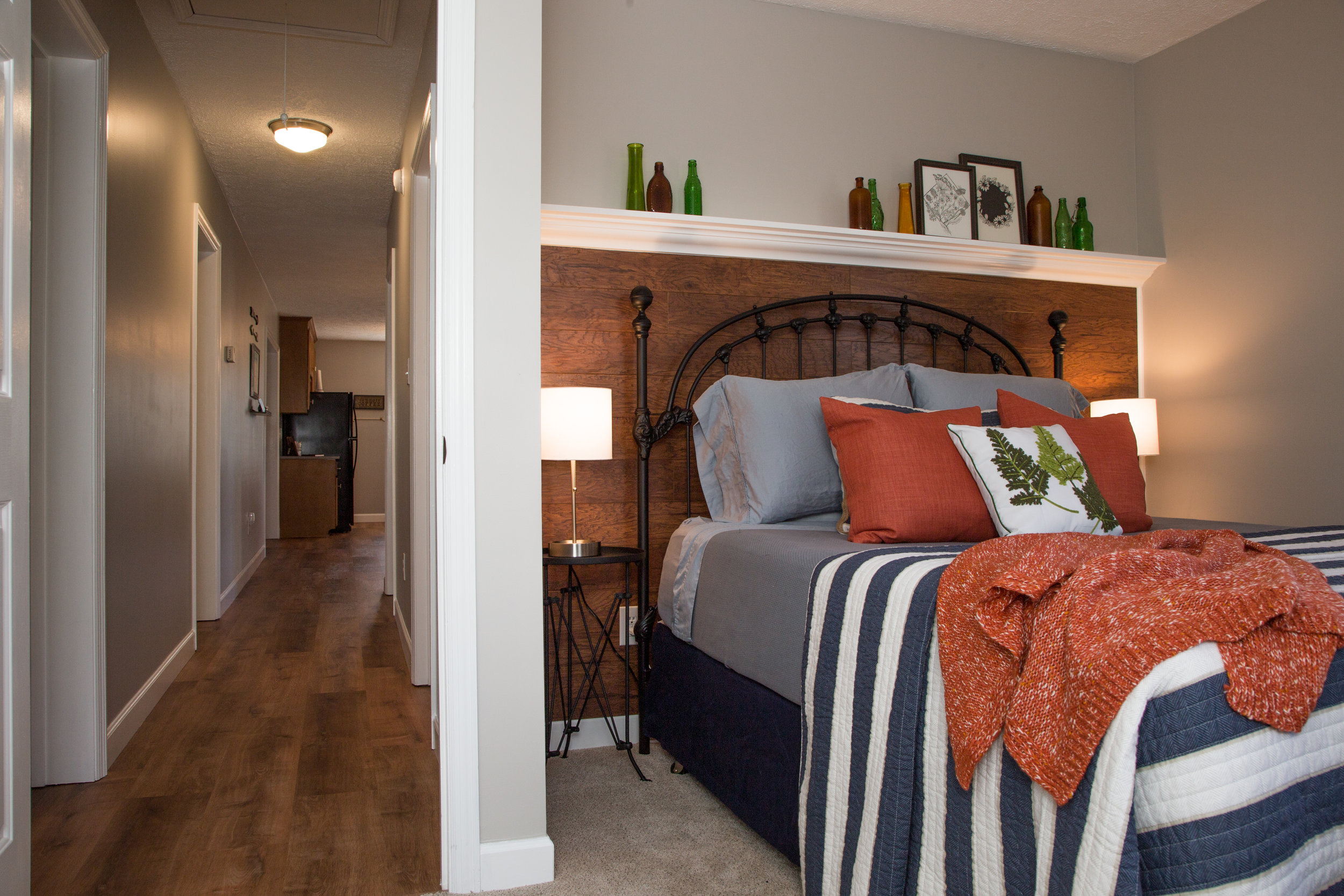 Cozy second bedroom with reclaimed-wood accent wall.