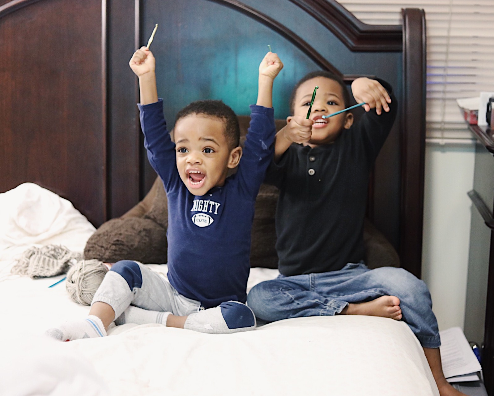 "Jaden & Jonathan cheer with their ""drumsticks"" after watching a Sight Word get dunked into some sauce. Or something like that haha."
