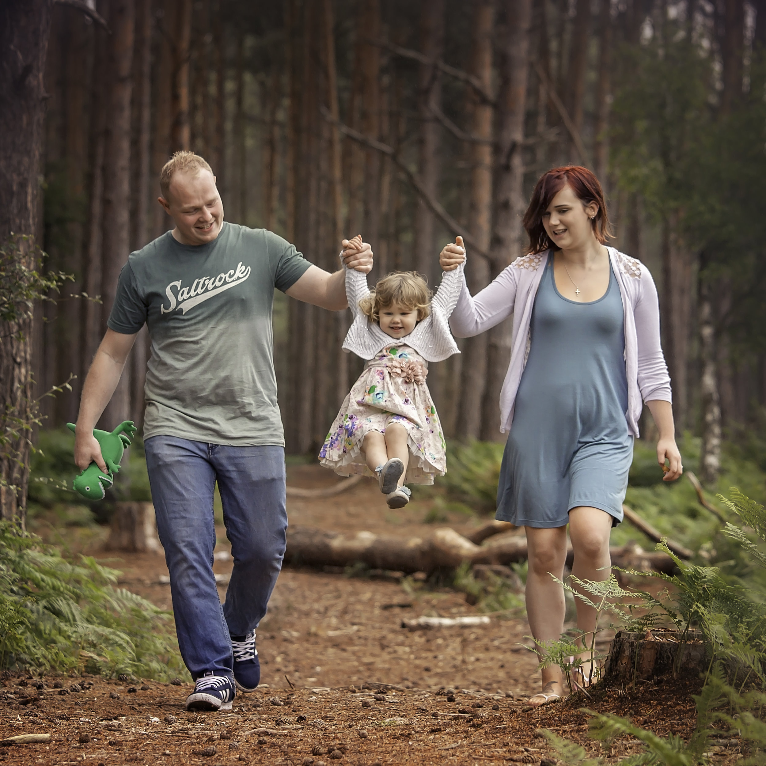 Yorkshire family photography: young family of 3 walking through the forest