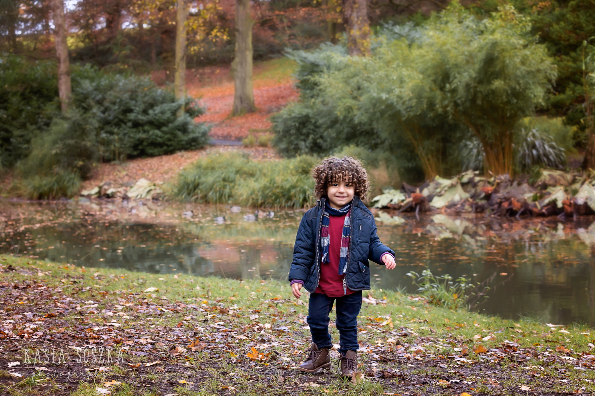 Yorkshire children photography: adorable little boy with dark curly hair in Temple Newsam, Leeds.