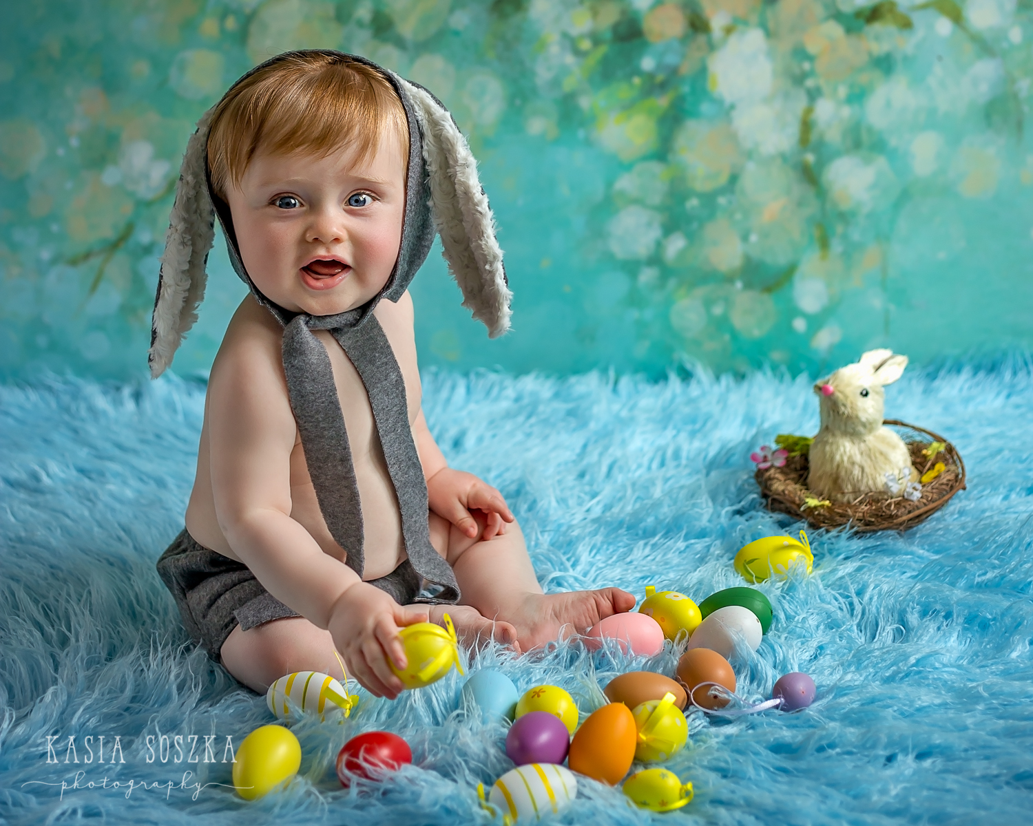 Leeds baby photographer: cute red head baby boy wearing Easter bunny outfit