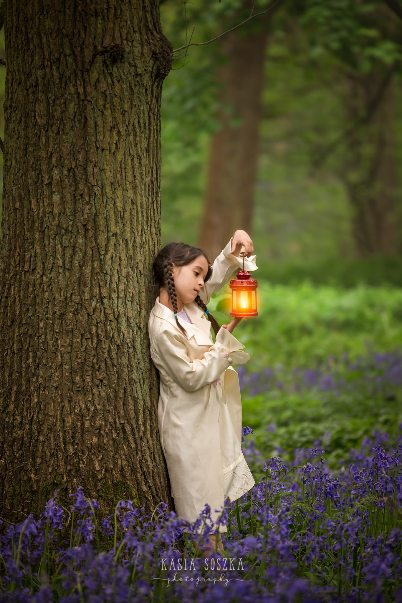 Yorkshire child photography: little girl holding a lantern in a bluebell forest