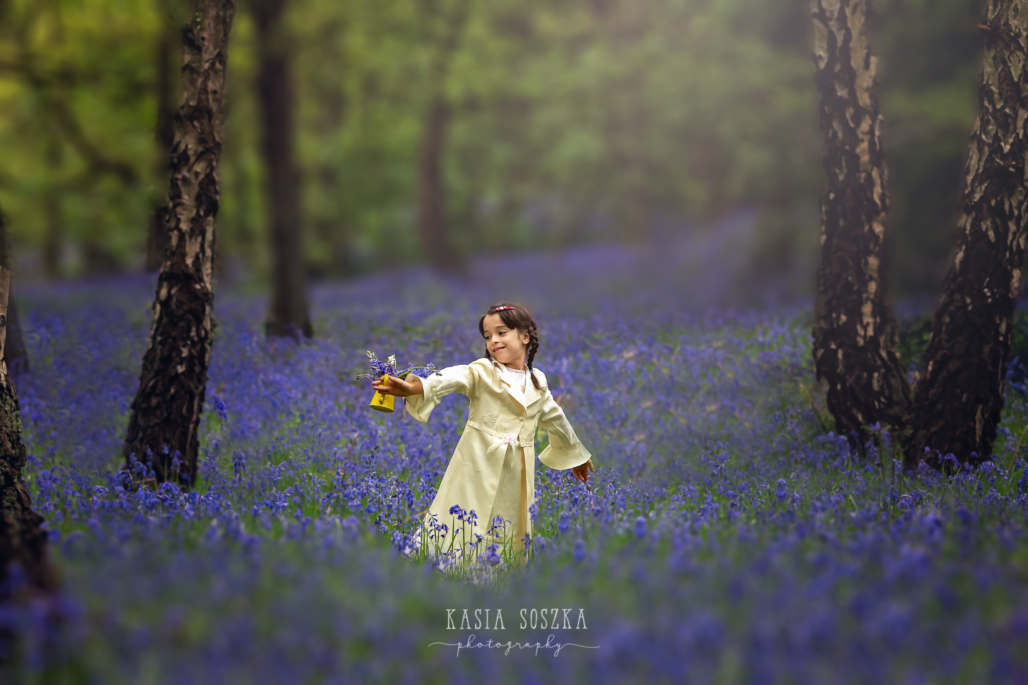 Leeds children outdoor photography: little girl dancing n the middle of bluebell woods.