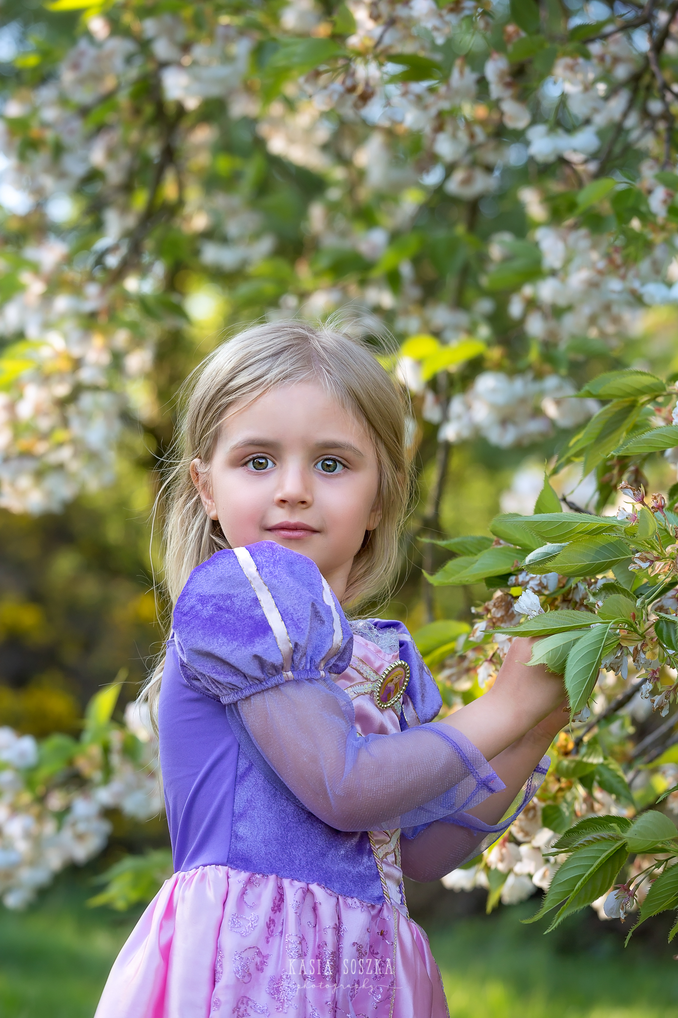 Leeds child photography Bradford child session York children photography: pretty little blond girl in a princess dress with apple blossoms