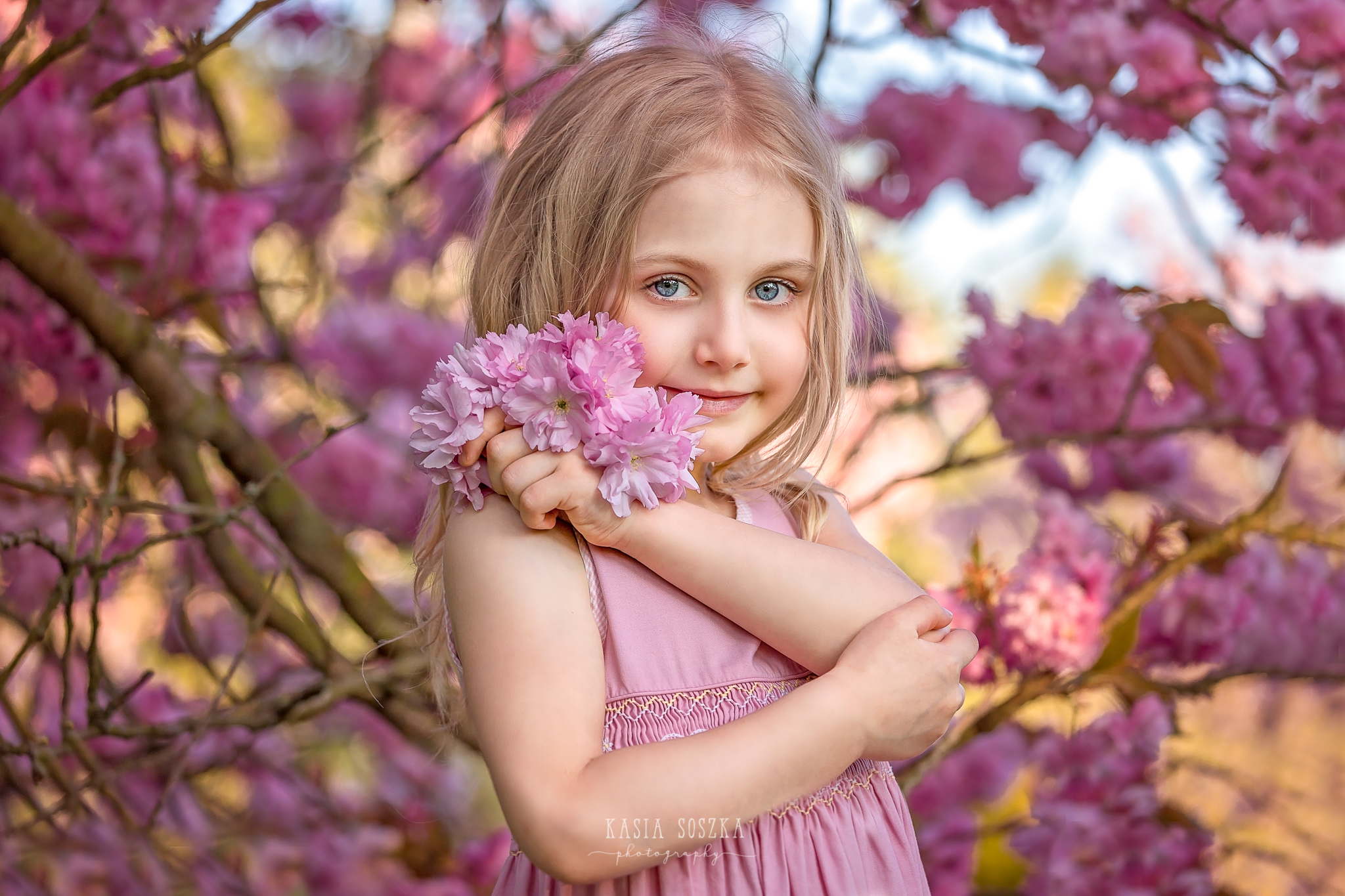 Leeds child photography Bradford child session York children photography: pretty little blond girl in a pink dress under blossoming cherry tree