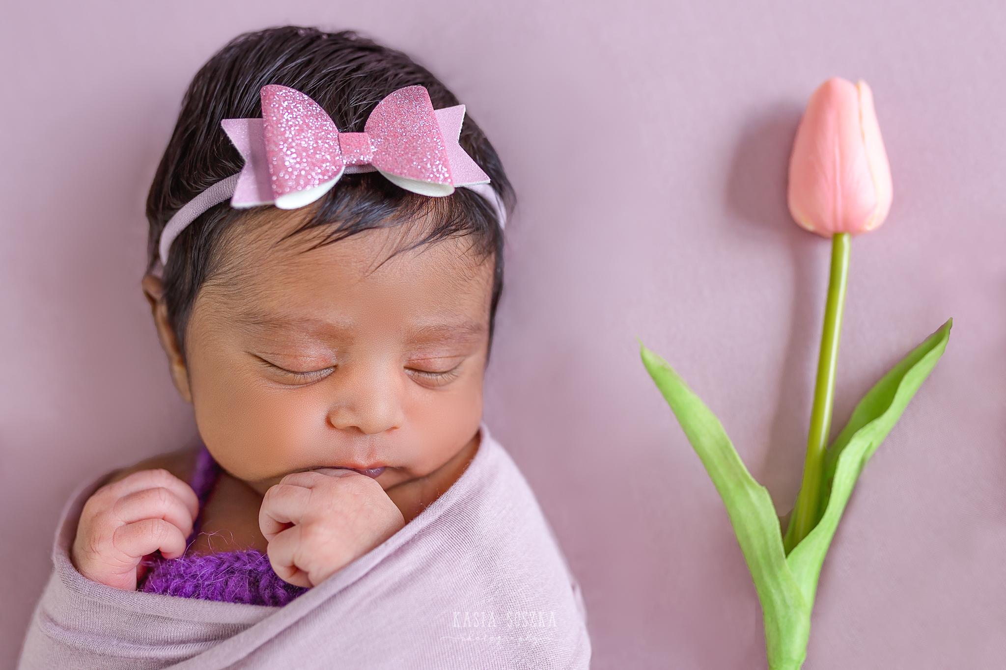 Newborn photography Leeds-Bradford-York-Harrogate: newborn baby girl on a pink blanket