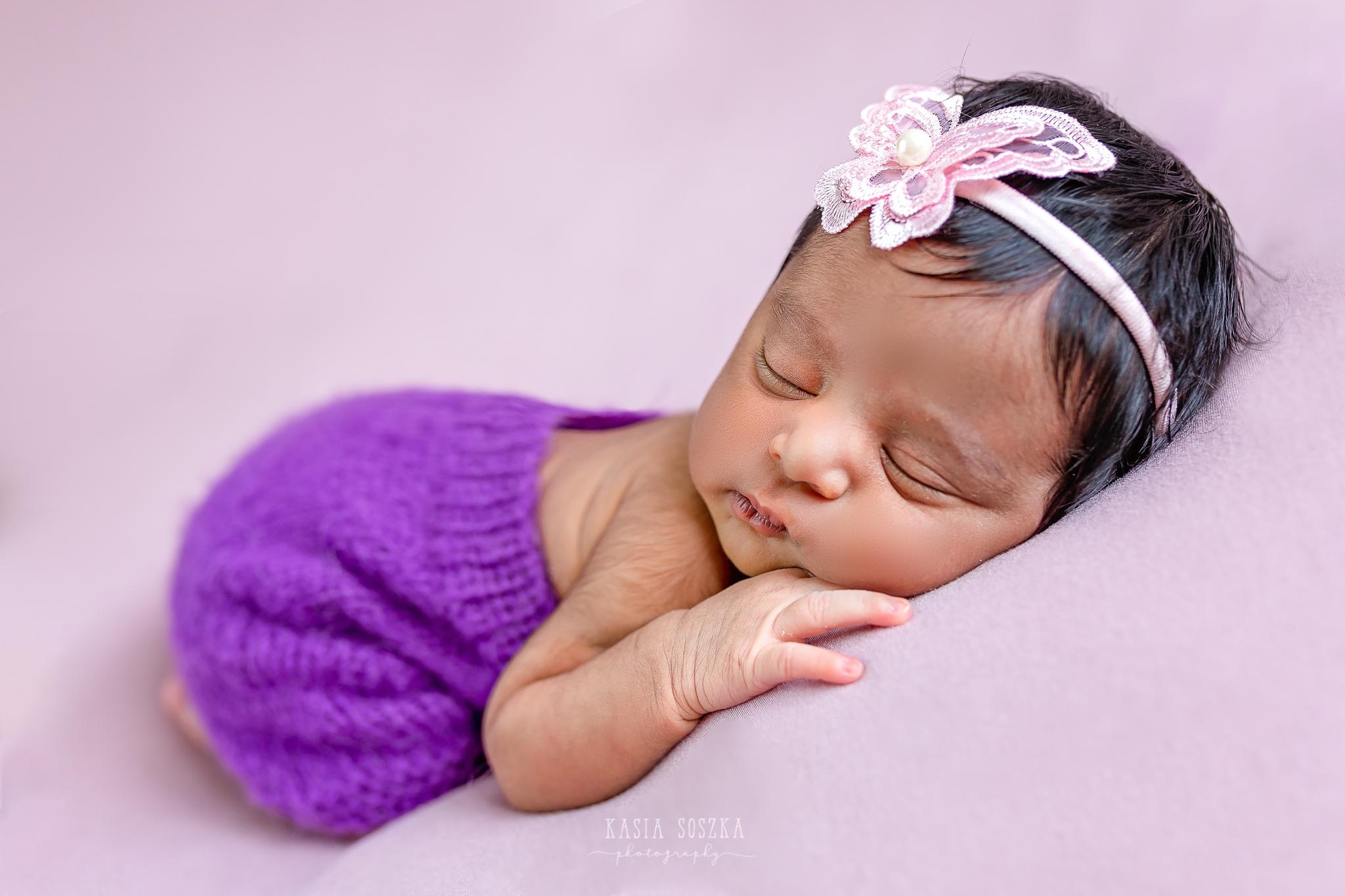 Newborn photography Leeds-Bradford-York-Harrogate: newborn baby girl sleeping on a pink blanket