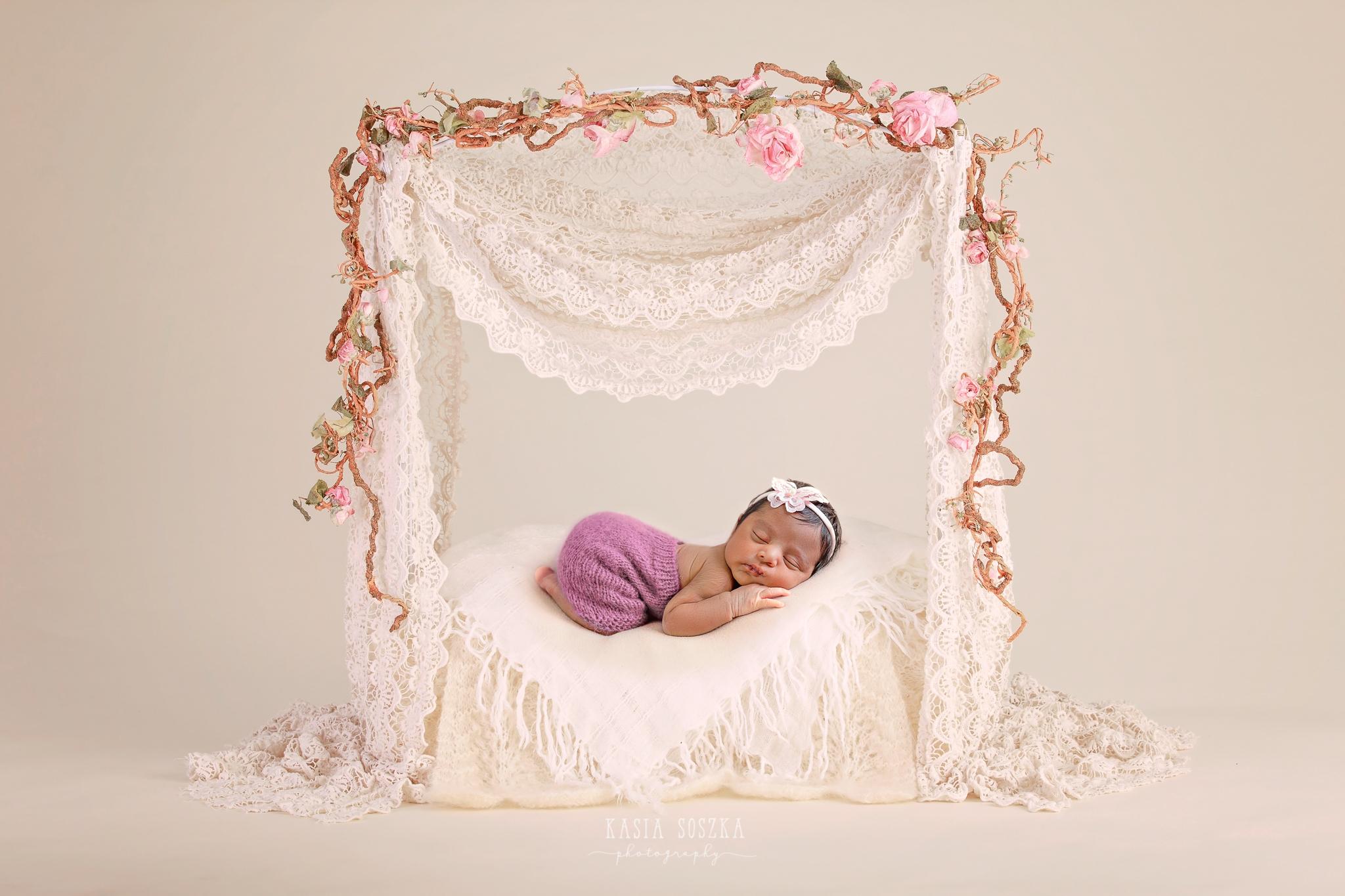 Newborn photography Leeds-Bradford-York-Harrogate: newborn baby girl sleeping on a vintage poster bed