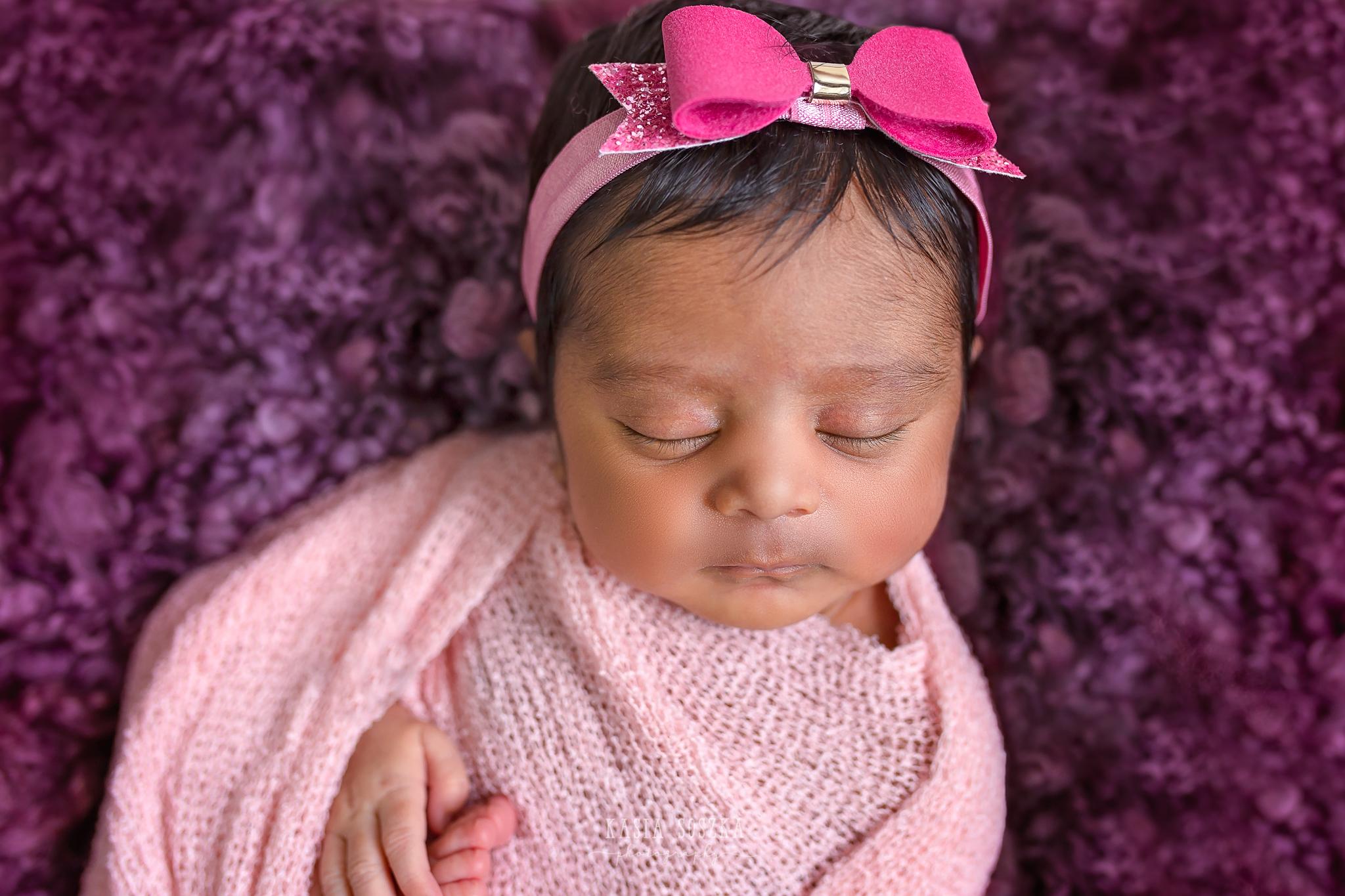 Newborn photography Leeds-Bradford-York-Harrogate: newborn baby girl wrapped in a pink blanket