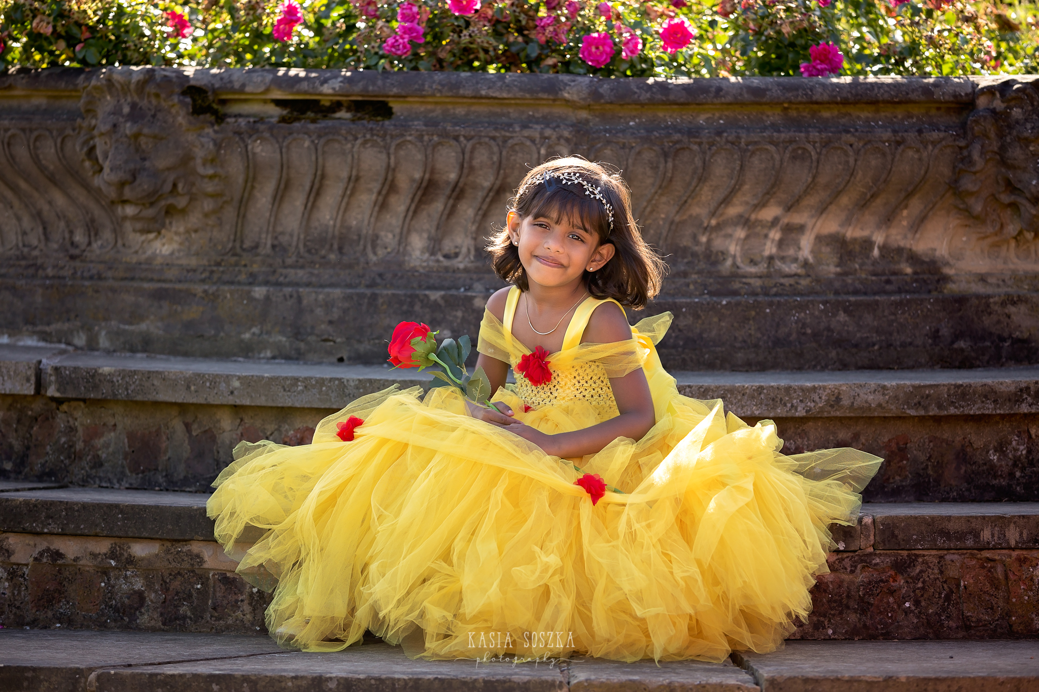 Child photography Leeds, child outdoor princess session Leeds, Yorkshire: beautiful little girl in a yellow princess dress in a garden