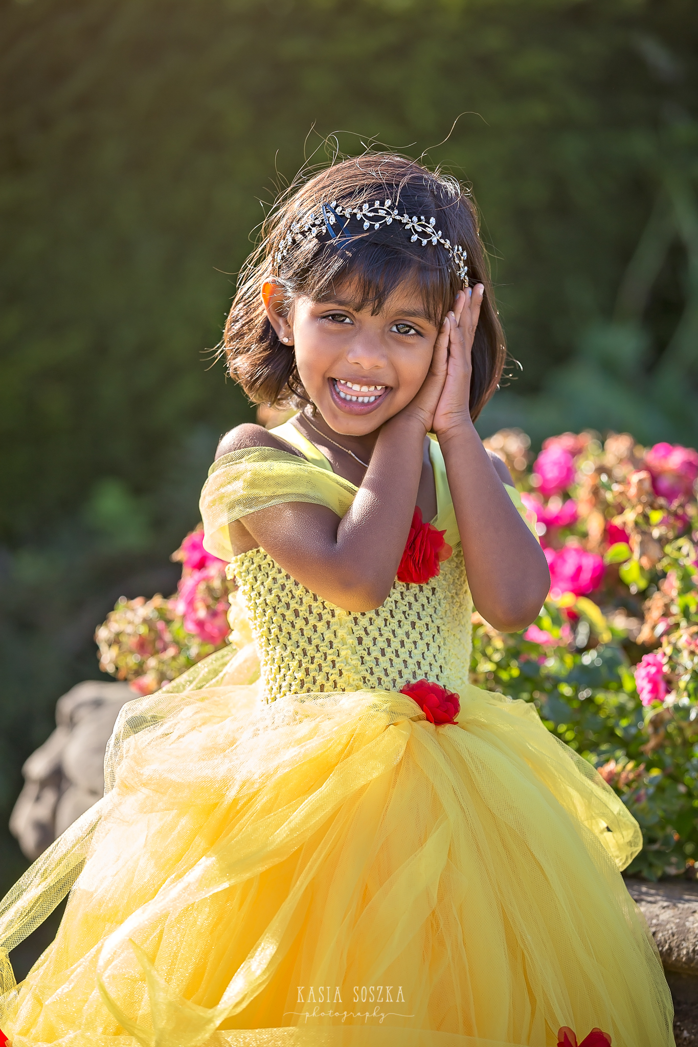 Child photography Leeds, child outdoor princess session Leeds, Yorkshire: beautiful little girl in a yellow princess dress running in a garden