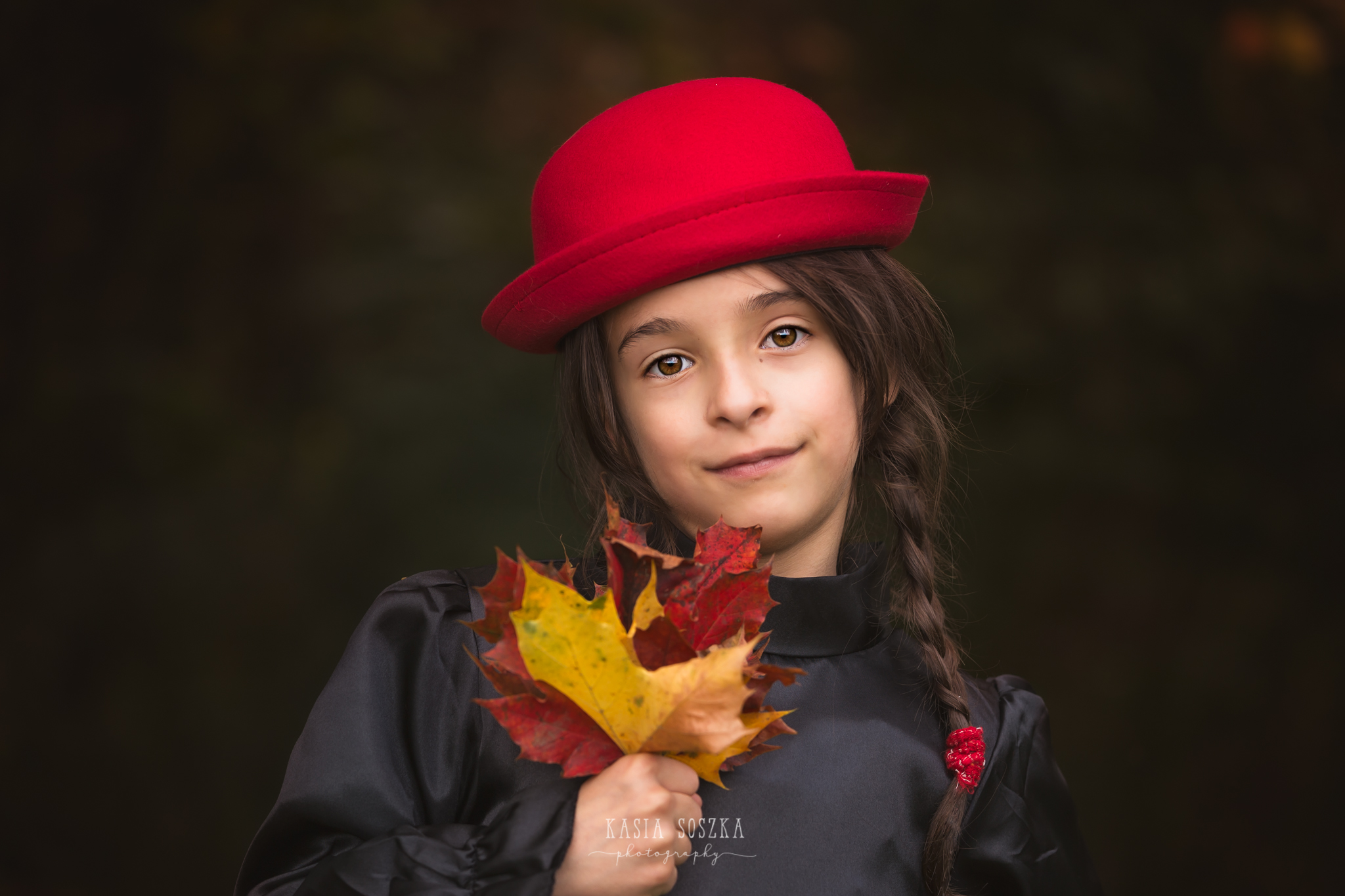 Child photography Leeds, York, Bradford., Harrogate: little girl in a red hat with autumn leaves. Child autumn session in Leeds, Yorkshire