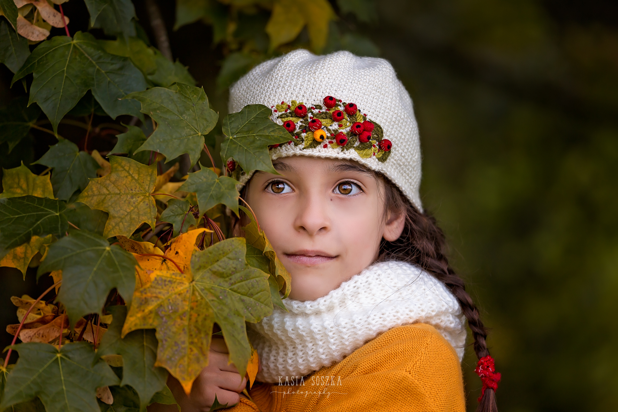 Child photography Leeds, York, Harrogate, Bradford: girl in yellow sweater and autumn leaves. Child session in Leeds, Yorkshire.