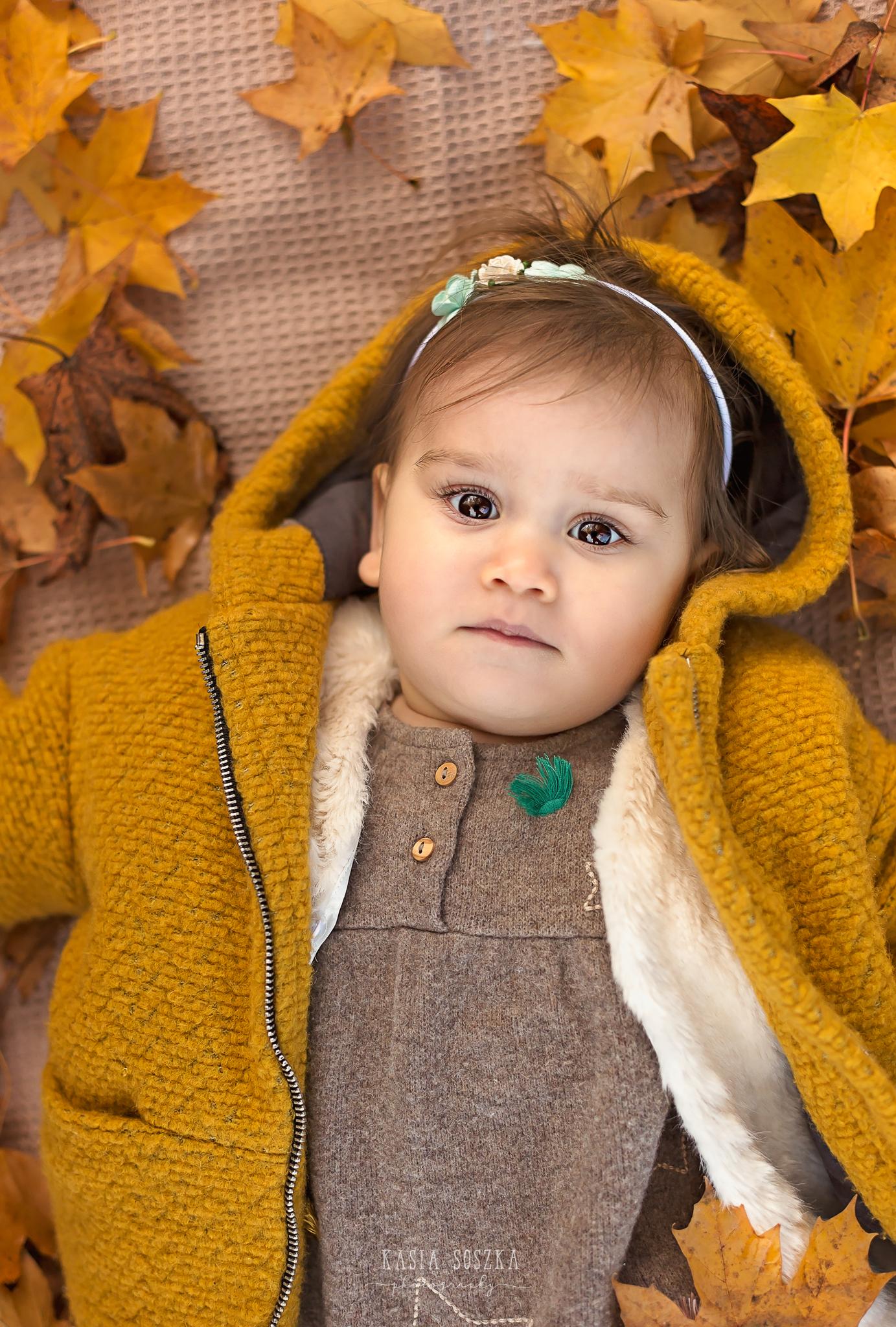 Baby milestone photography Leeds, York, Bradford, Harrogate: cute baby girl's first birthday portrait session. Autumn outdoor baby photo shoot in Leeds, Yorkshire