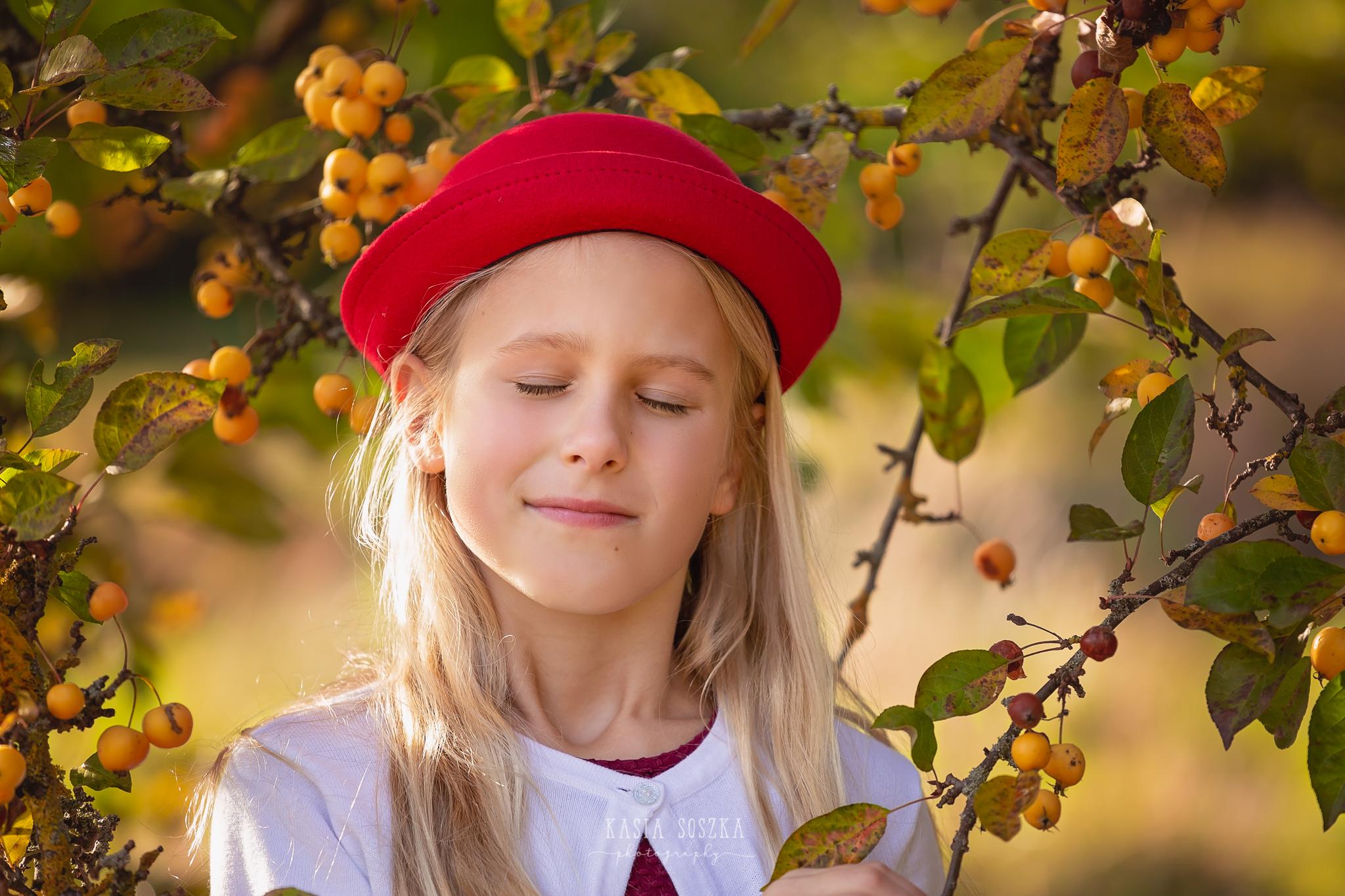Children photography, child photographer Leeds, York, Bradford, Harrogate: pretty blond girl under yellow berry tree