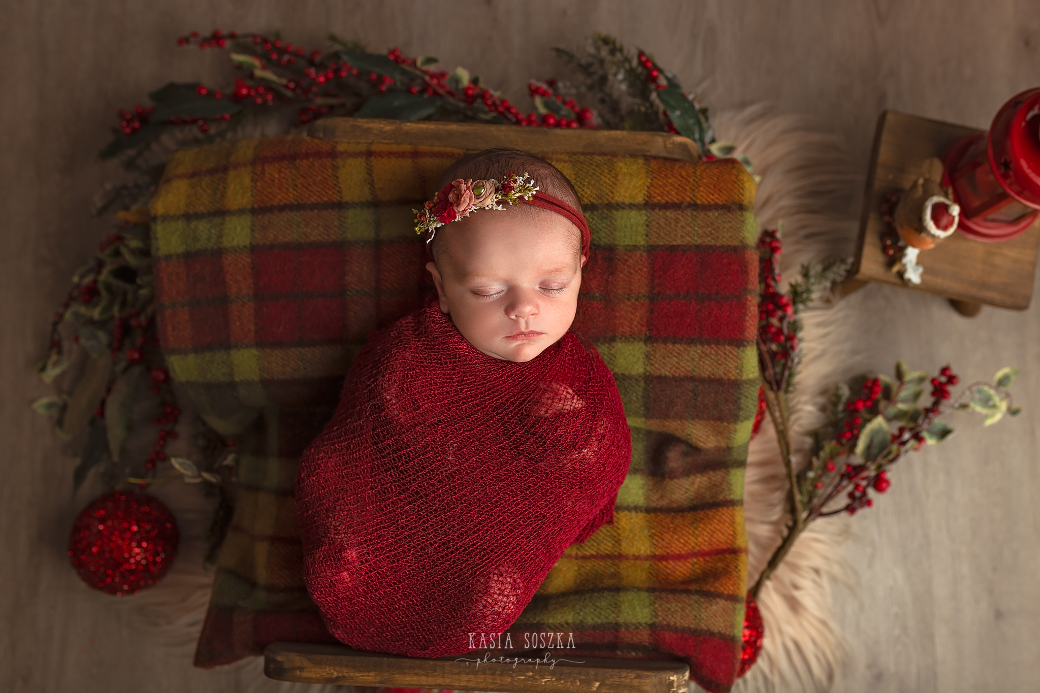 Newborn photography in Leeds near Bradford, York and Harrogate: cute newborn baby girl in Christmas set up
