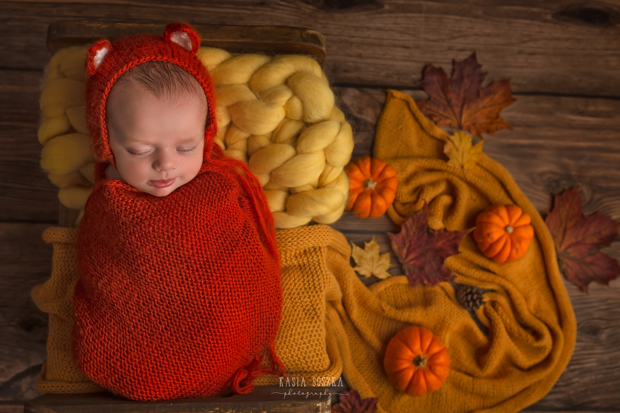 Newborn photography in Leeds near Bradford, York and Harrogate: cute newborn baby girl in fox outfit during her autumn themed newborn session