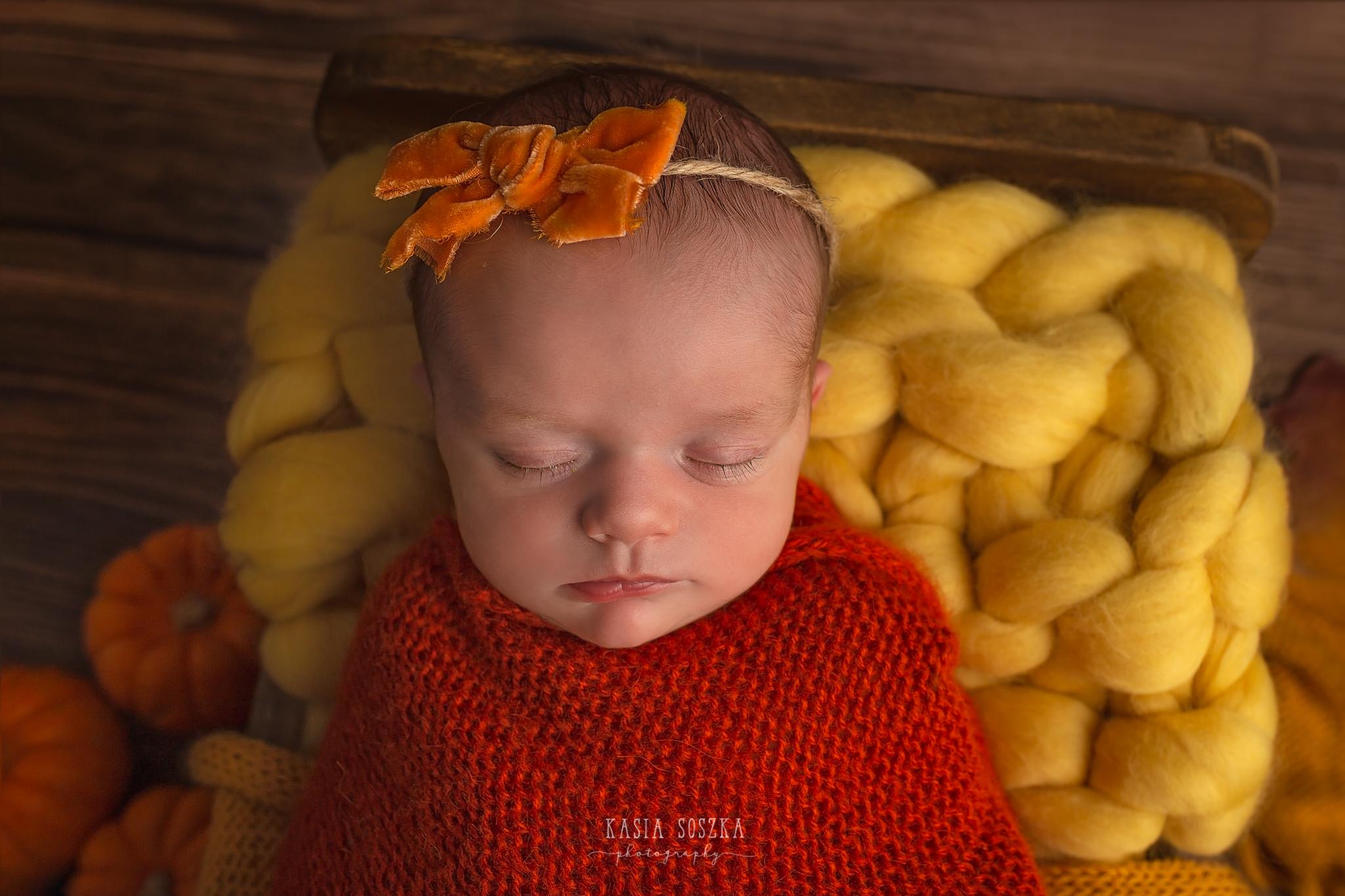 Newborn photography in Leeds near Bradford, York and Harrogate: cute newborn baby girl in autumn set up