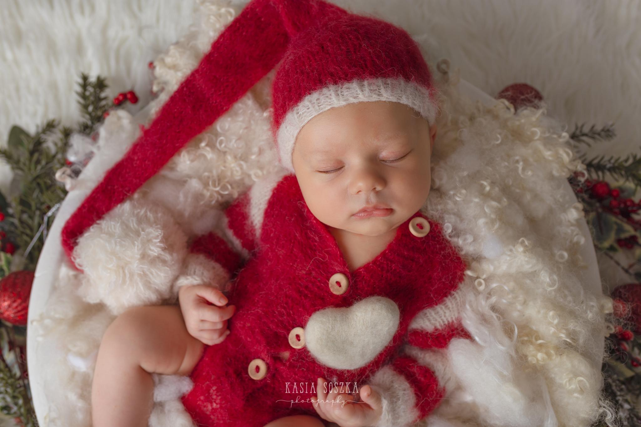 Newborn photography Leeds-York-Bradford-Harrogate: Christmas newborn session in Leeds, Yorkshire. Cute newborn baby girl in Santa Claus outfit.