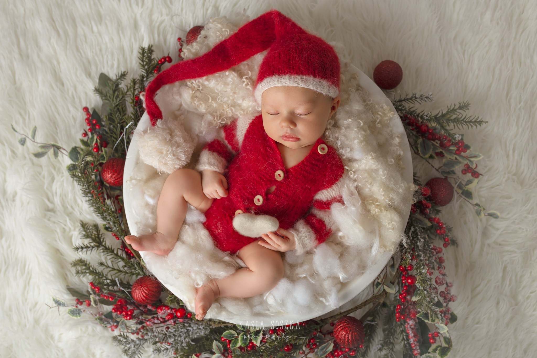 Newborn photography Leeds-York-Bradford-Harrogate: Christmas newborn session in Leeds, Yorkshire. Cute newborn baby girl in Santa Claus outfit