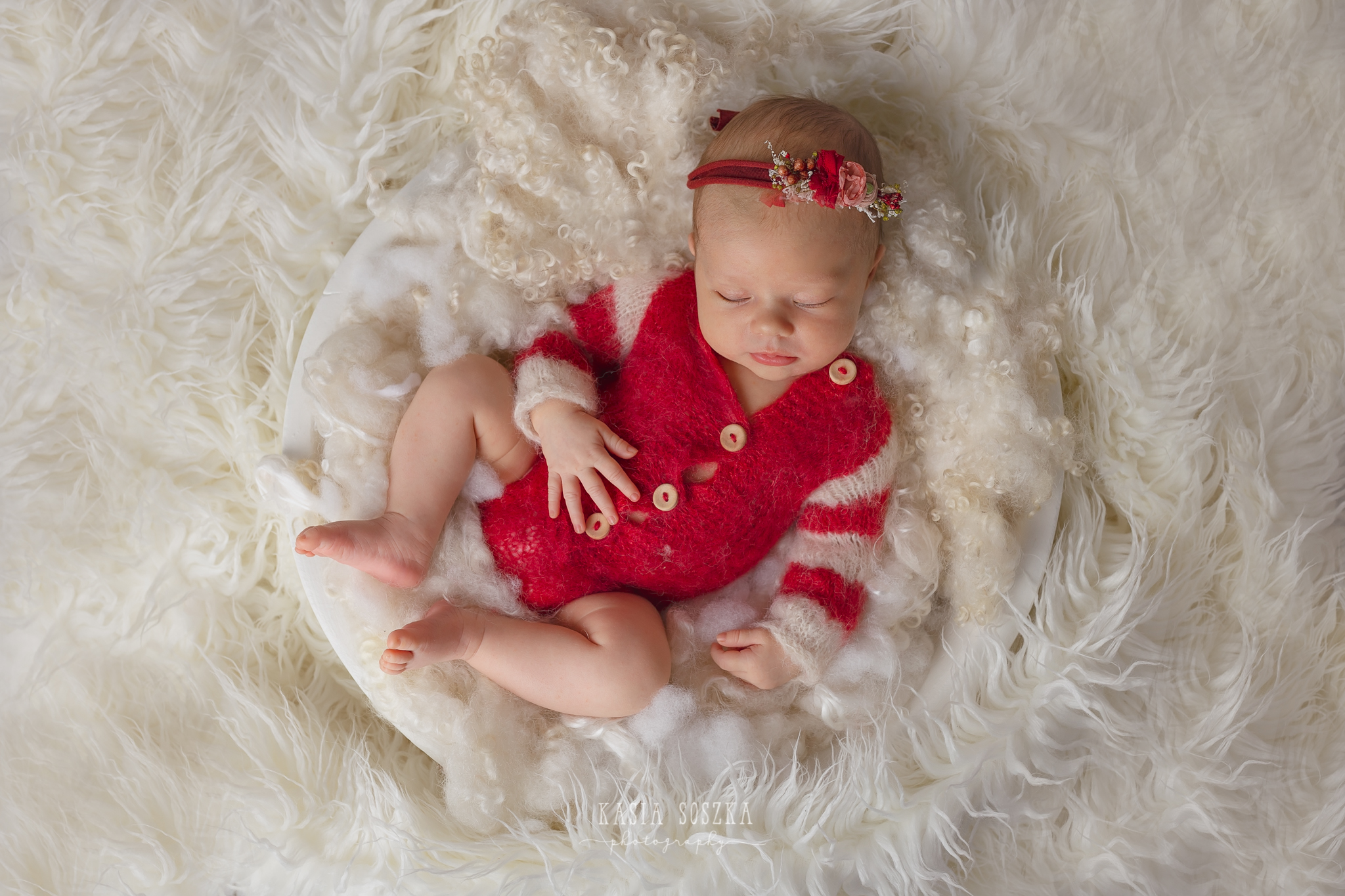 Newborn photography Leeds-York-Bradford-Harrogate: Christmas newborn session in Leeds, Yorkshire. Cute newborn baby girl in Christmas outfit