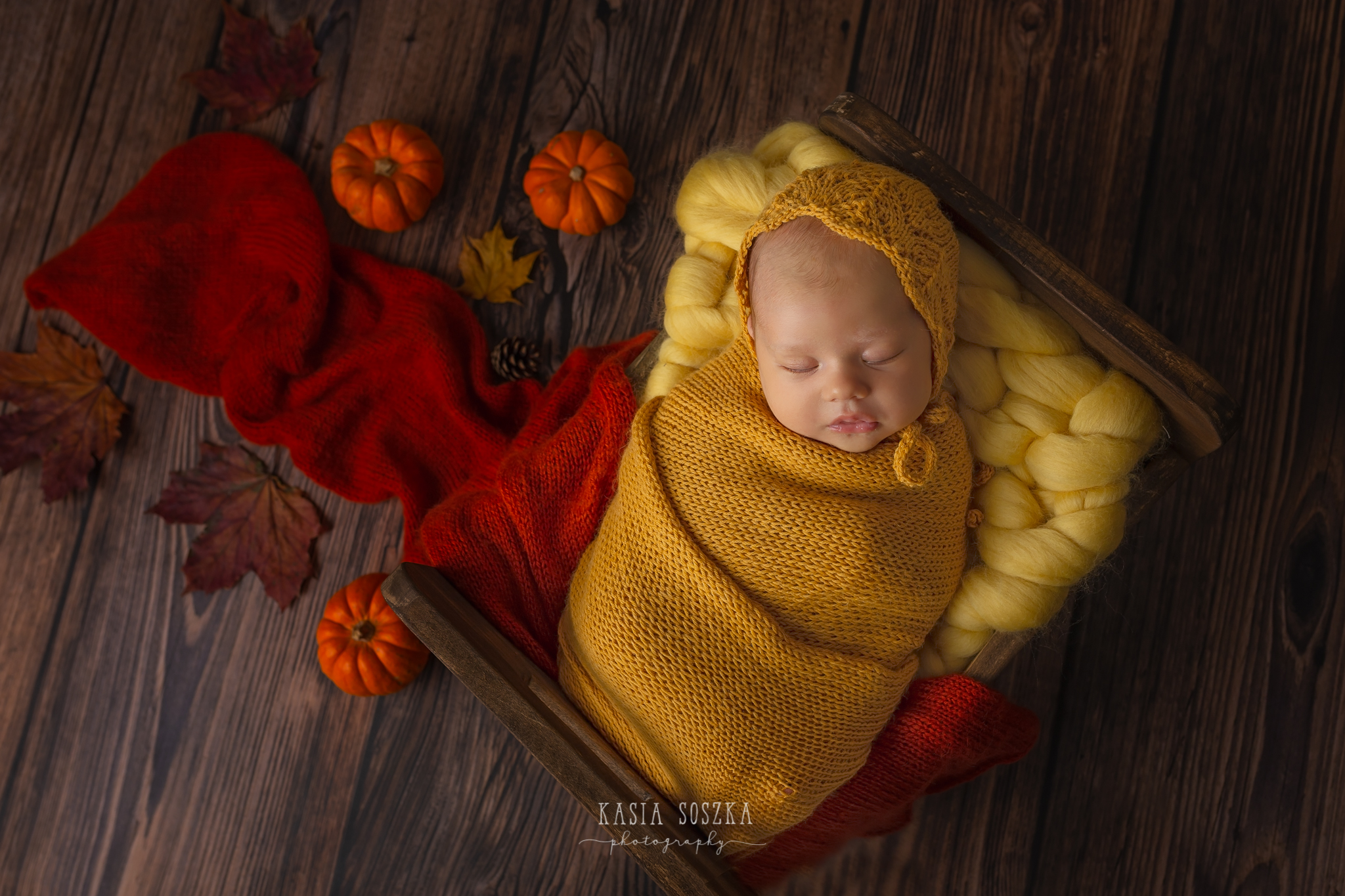 Newborn photography Leeds-York-Bradford-Harrogate: autumn themed newborn session in Leeds, Yorkshire. Cute newborn baby girl in an autumn set up