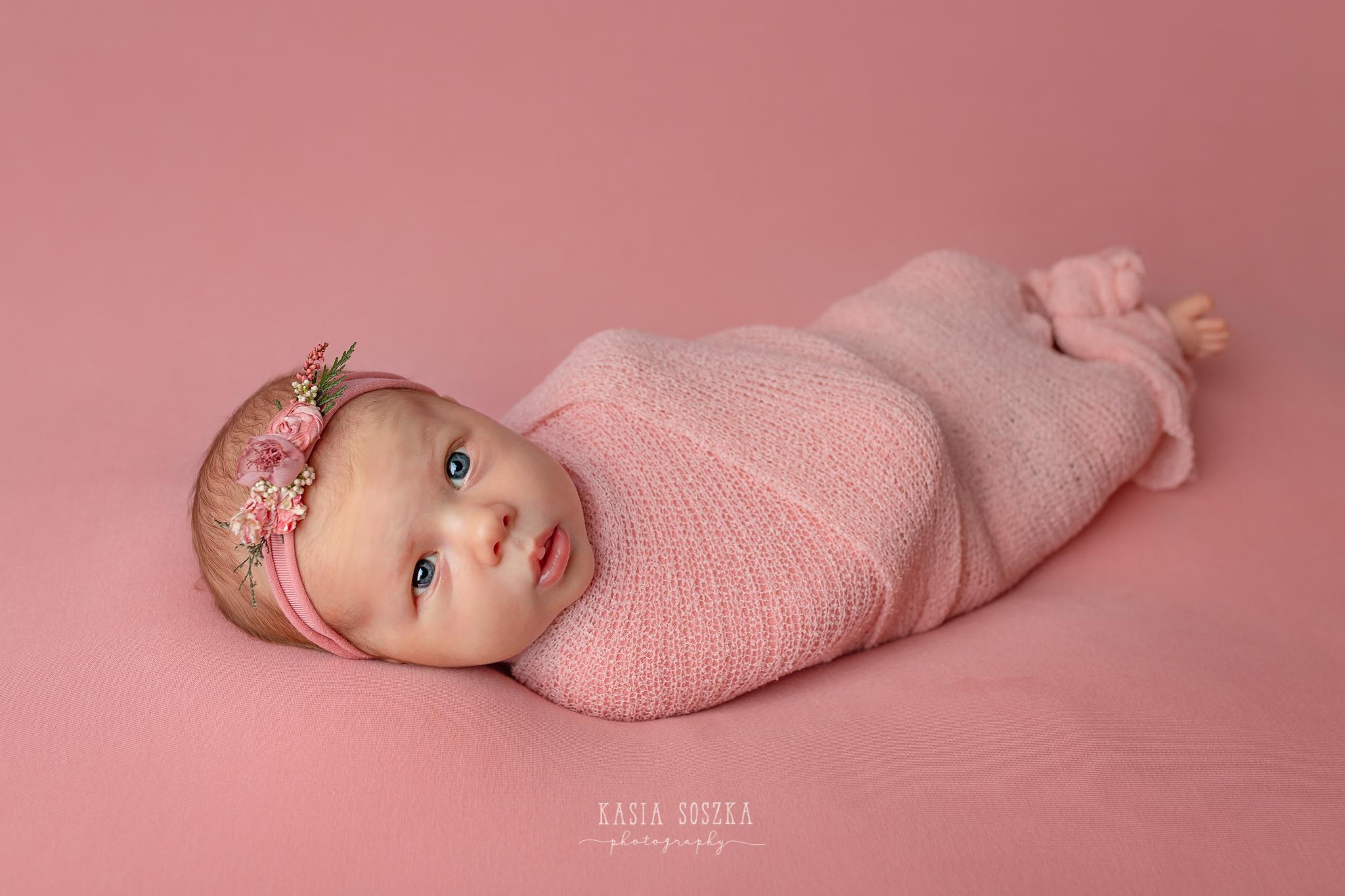 Newborn photography Leeds-York-Bradford-Harrogate: cute newborn baby girl lying on a pink blanket