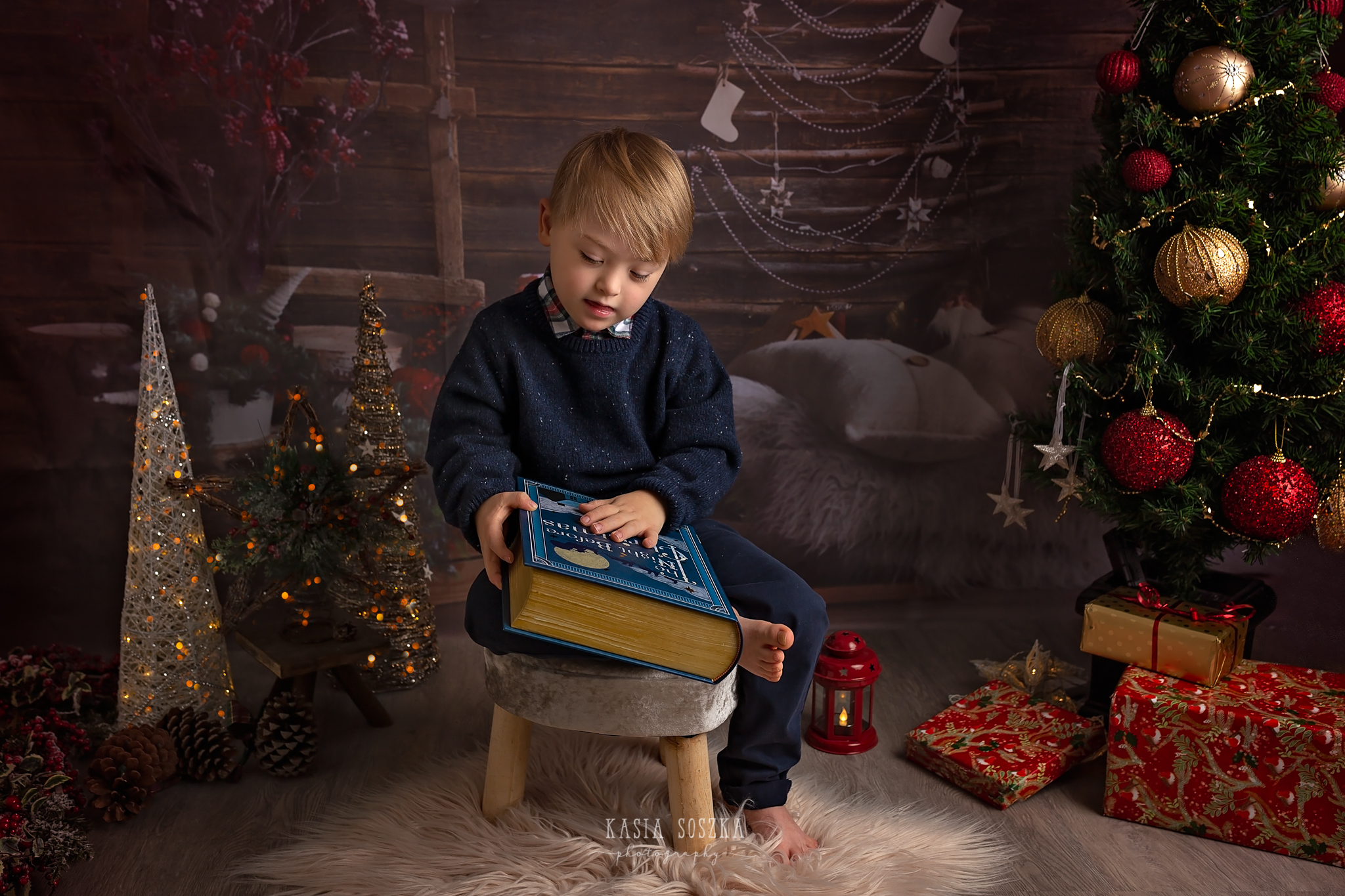 Child photographer Leeds, York, Bradford, Harrogate. Christmas Mini Sessions 2018 Leeds: adorable little boy with Christmas story book