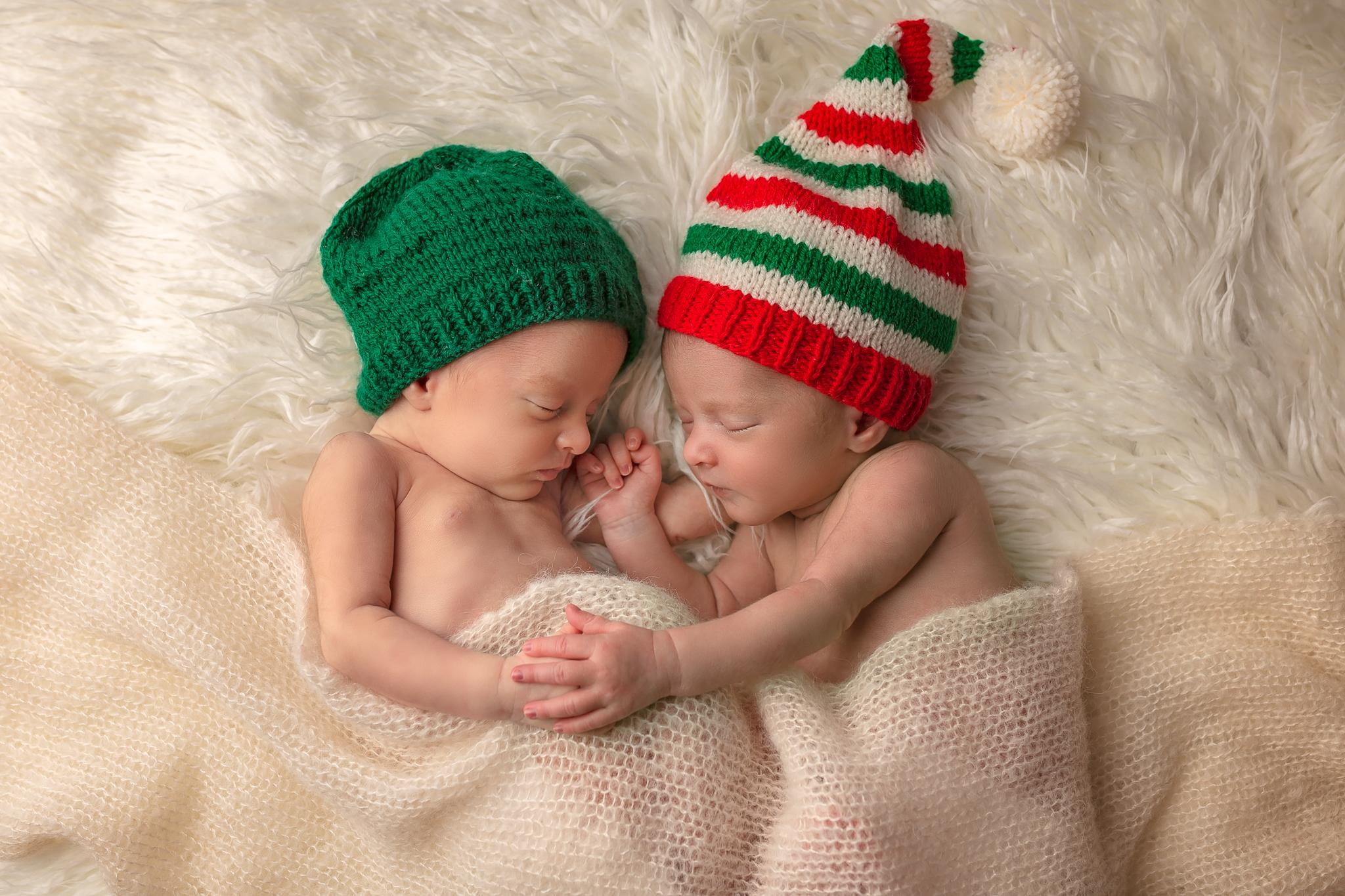 Newborn twin photographer Leeds, newborn photographer Leeds-York-Harrogate-Bradford, Yorkshire: winter theme twin session in Leeds, Yorkshire. Twin baby girls sleeping on a white blanket