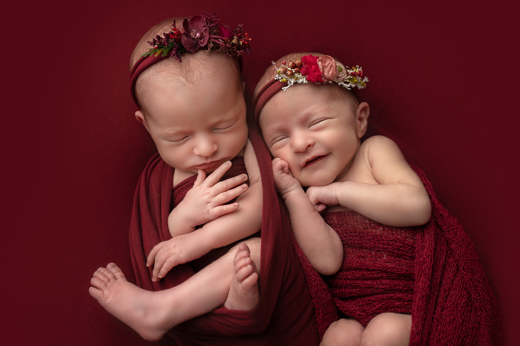 Newborn twin photographer Leeds, newborn photographer Leeds-York-Harrogate-Bradford, Yorkshire: winter theme twin session in Leeds, Yorkshire. Twin baby girls sleeping on a red blanket
