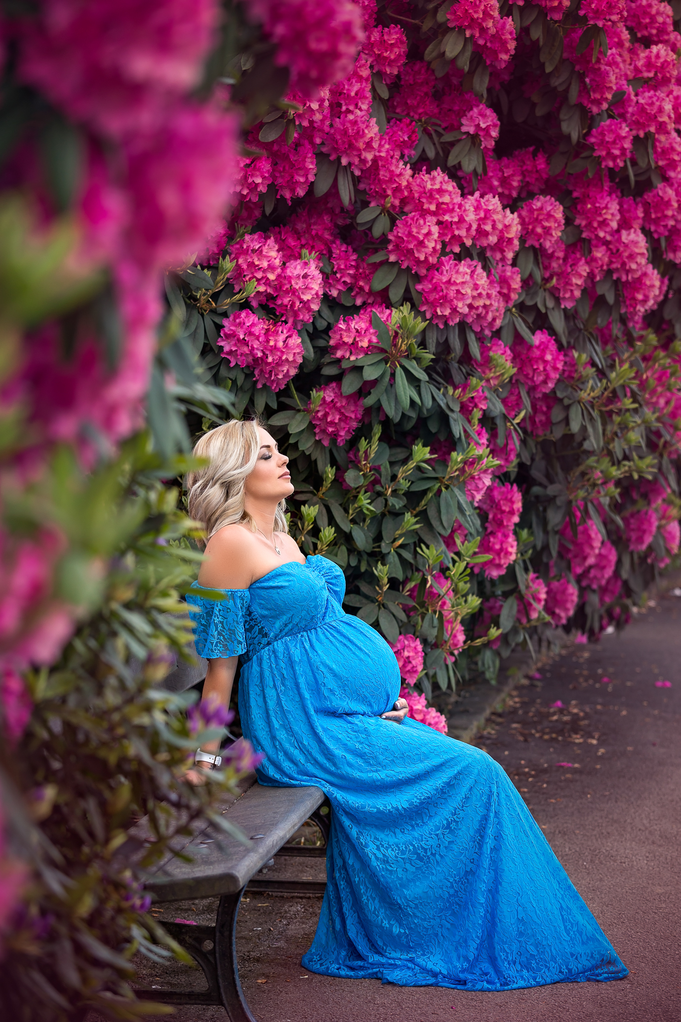Maternity photography Leeds, York, Harrogate, Bradford: pregnant woman resting on a bench in a spring garden. spring maternity session in leeds, yorkshire